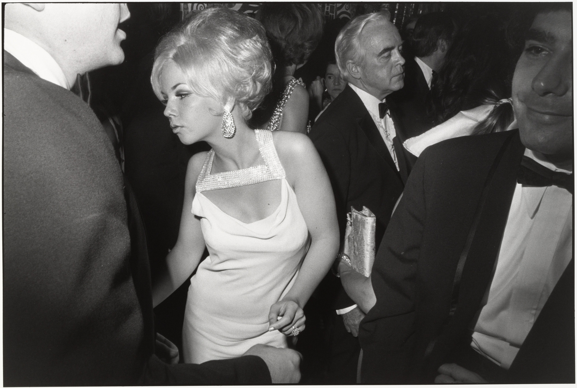 Garry Winogrand. Centennial Ball, Metropolitan Museum, New York from Women are Beautiful. 1969