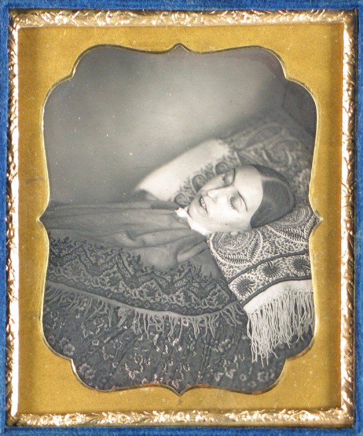 Unknown photographer. Death Portrait of a Woman Lying On a Bed of Patterned Material. c. 1850