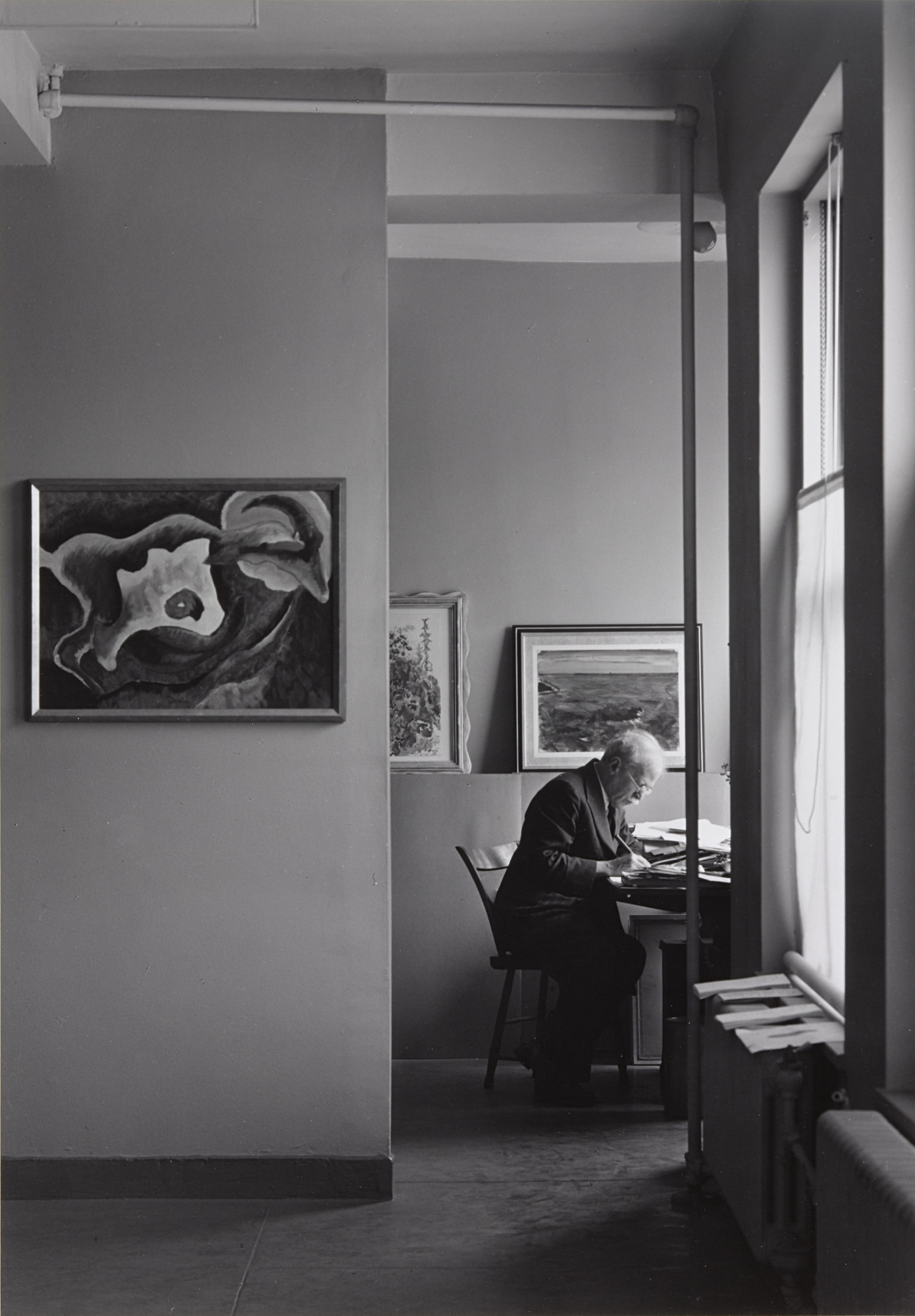 Ansel Adams. Alfred Stieglitz at his desk at An American Place. 1938