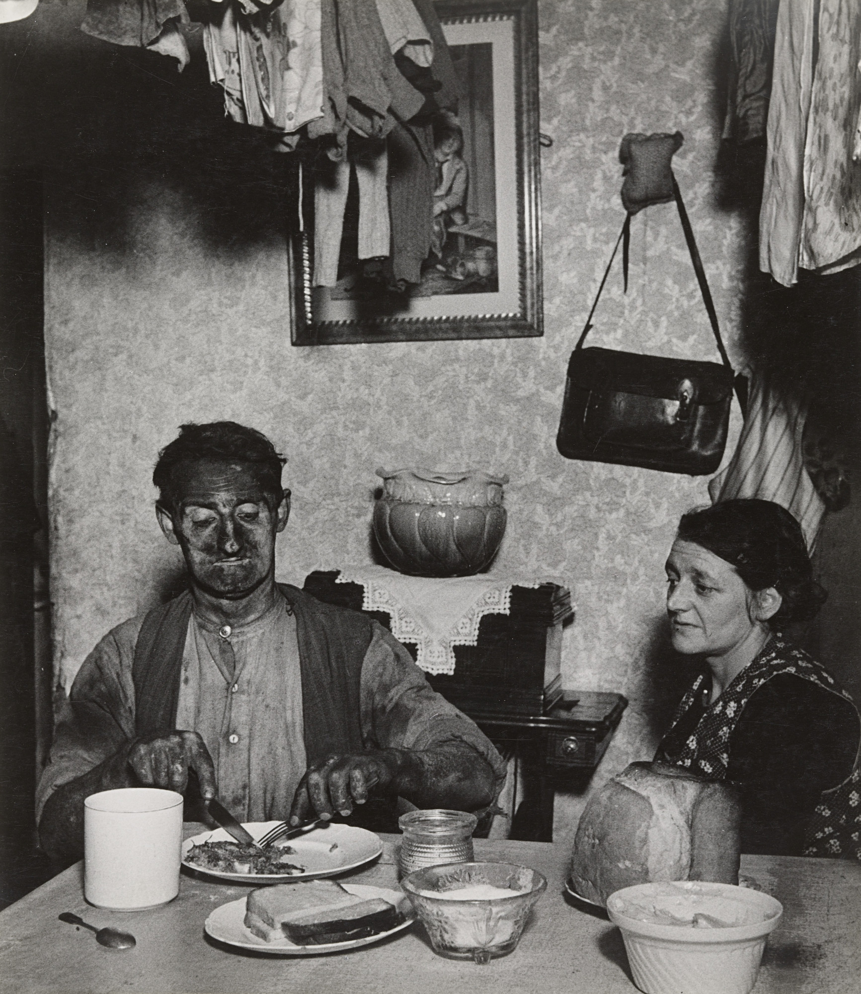 Bill Brandt. Northumbrian Miner at His Evening Meal. 1937