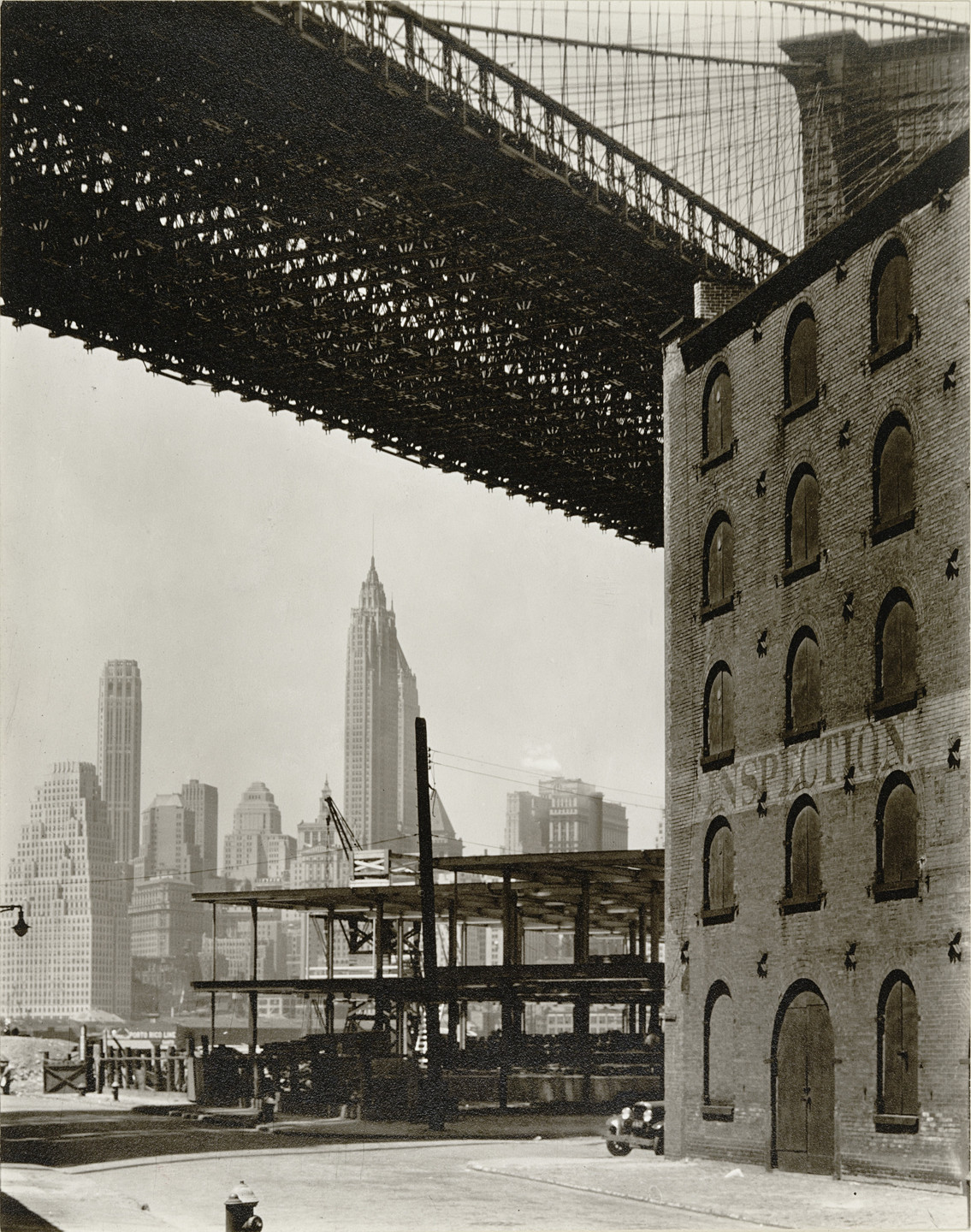 Berenice Abbott. Brooklyn Bridge, Water and New Dock Streets, Brooklyn. May 22, 1936