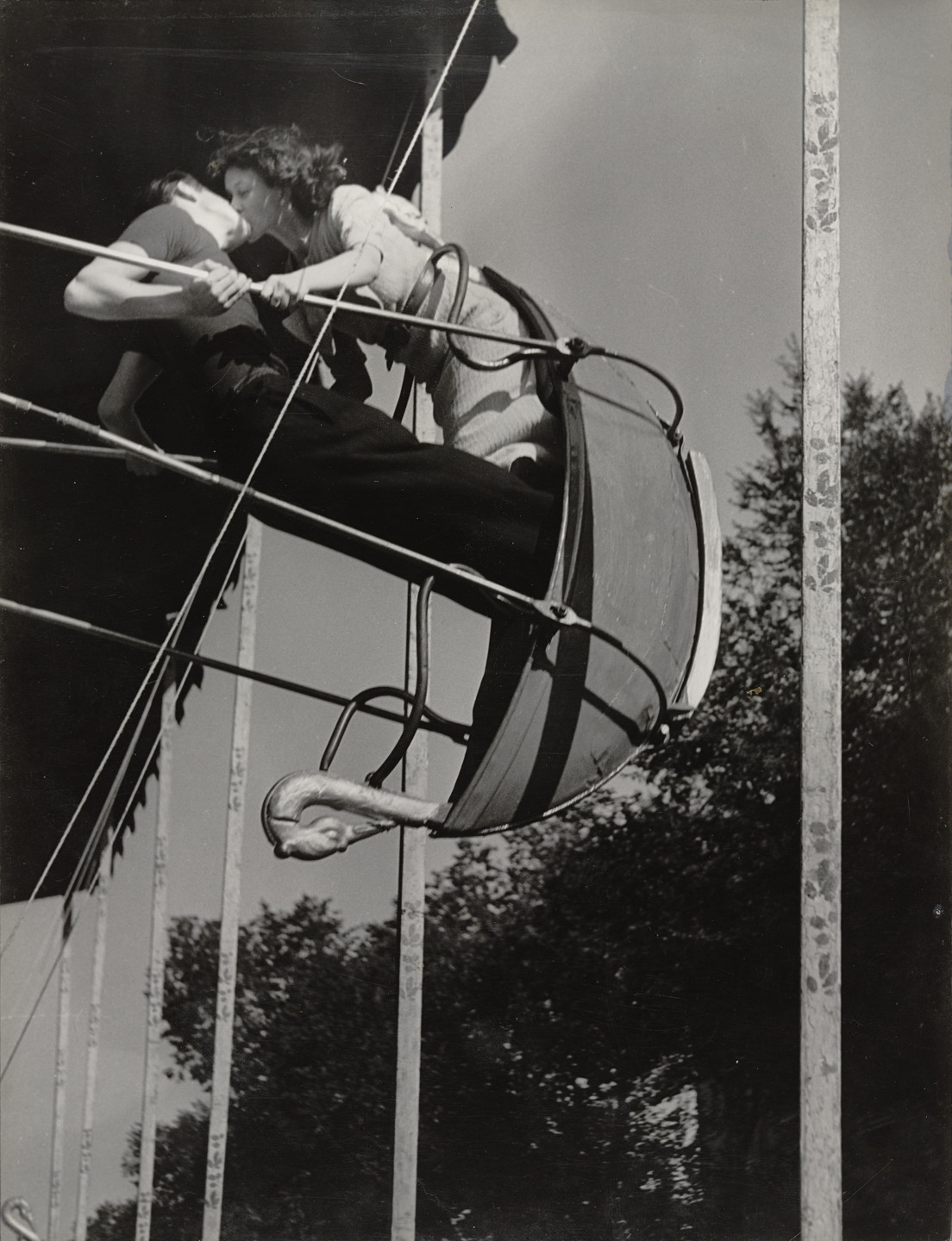 Brassaï (Gyula Halász). Kiss on a Swing at a Street Fair. c. 1936