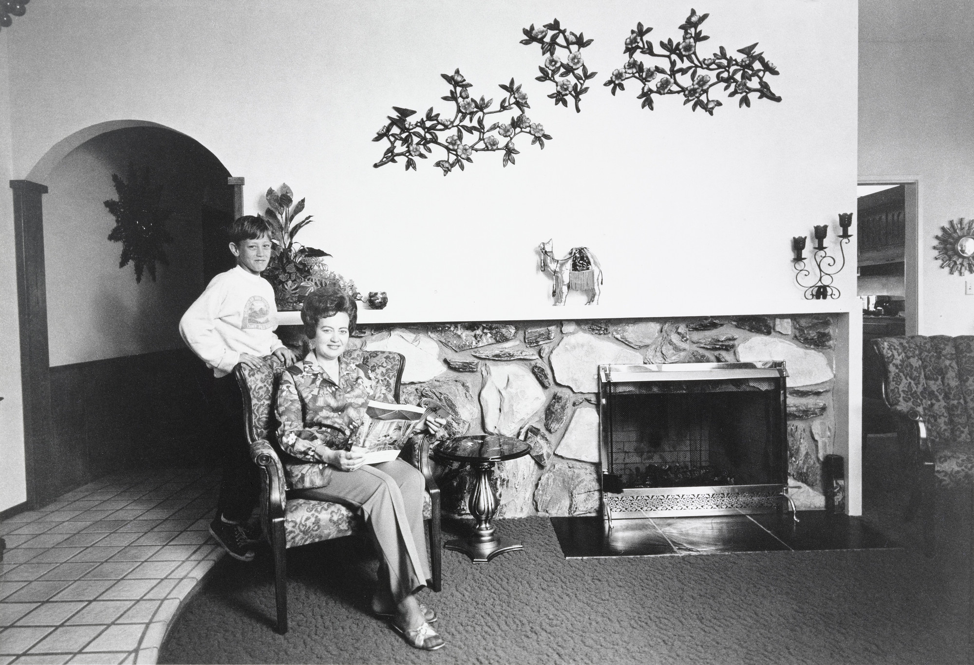 Bill Owens. I get a lot of compliments on the front room wall. I like Italian Syrocco floral designs over the mantle. It goes with the Palos Verde rock fireplace.. 1972