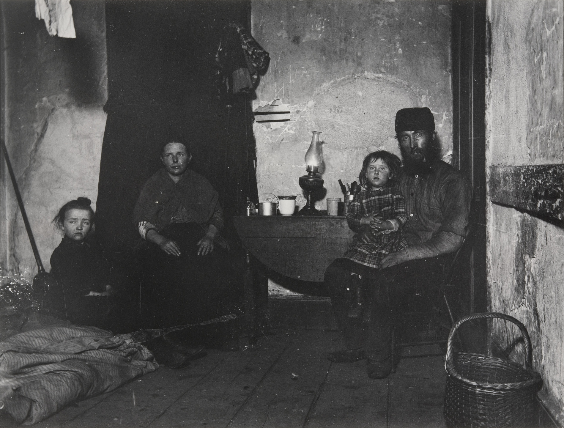 Jacob August Riis. In Poverty Gap, West 28th Street: An English Coal-heaver's Home. 1889