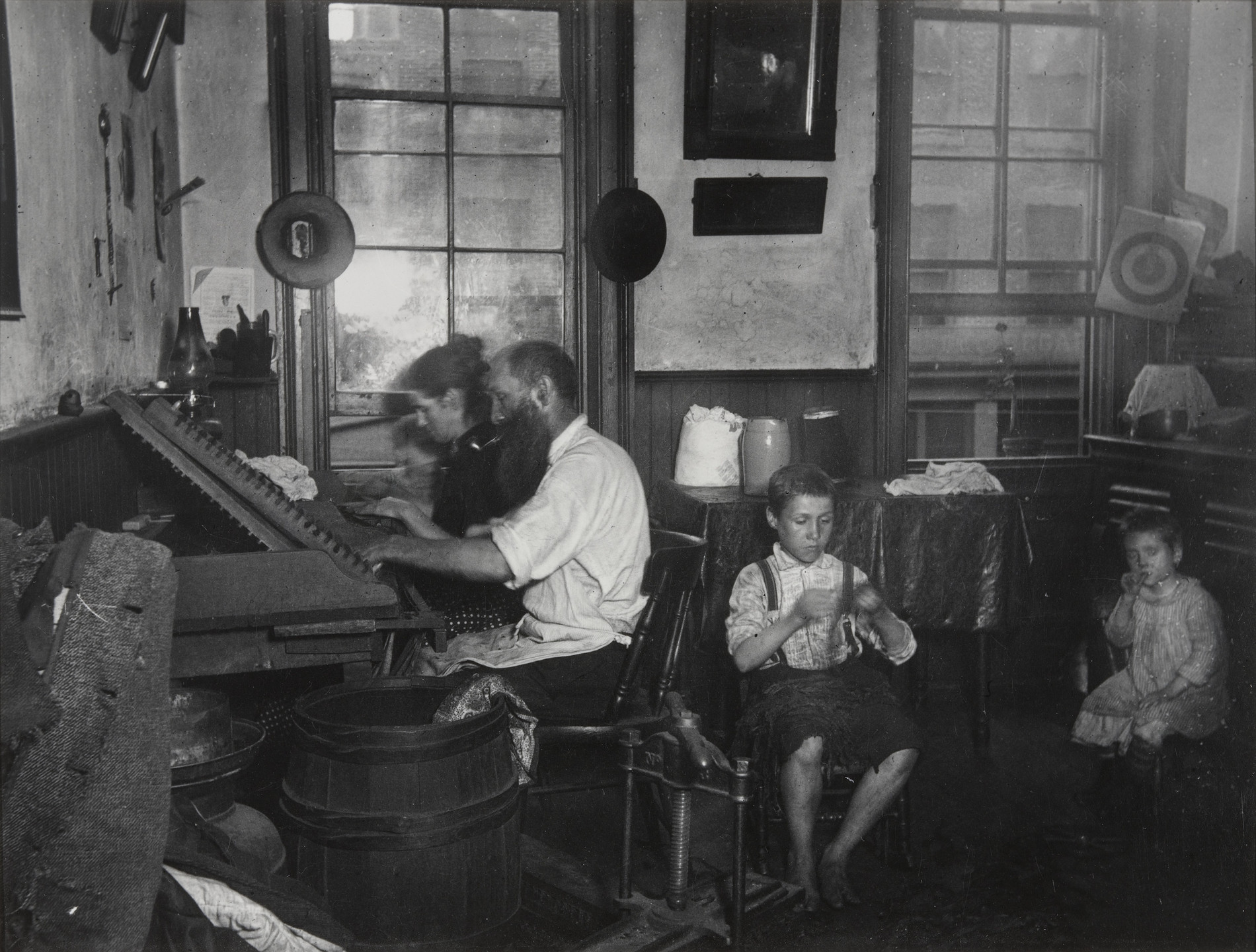 Jacob August Riis. Bohemian Cigarmakers at Work in Their Tenement. 1889