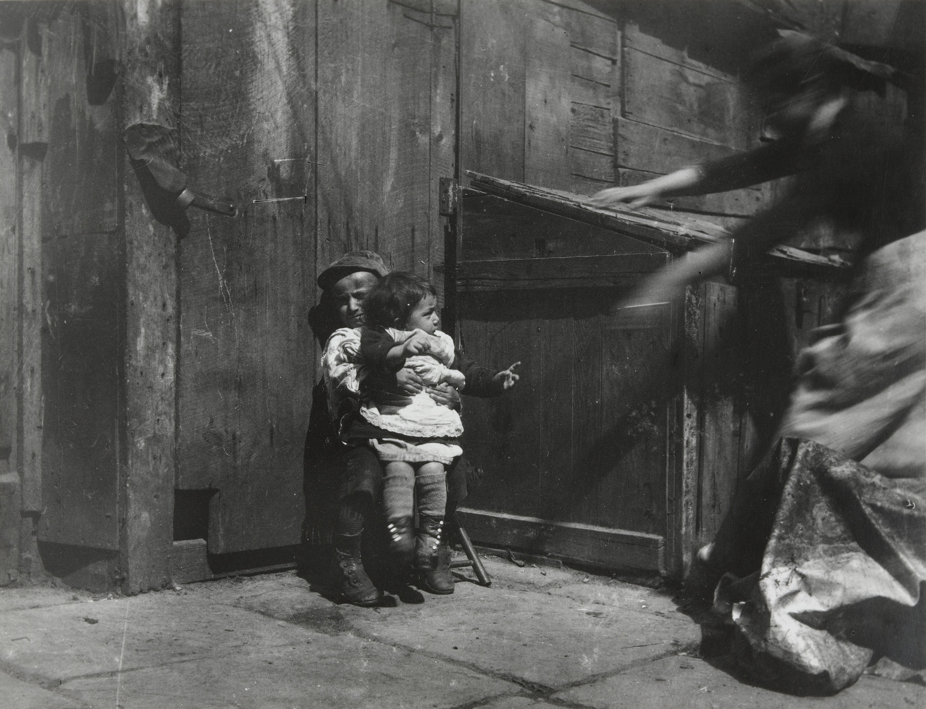 Jacob August Riis. Minding the Baby. Scene in Gotham Court. 1889