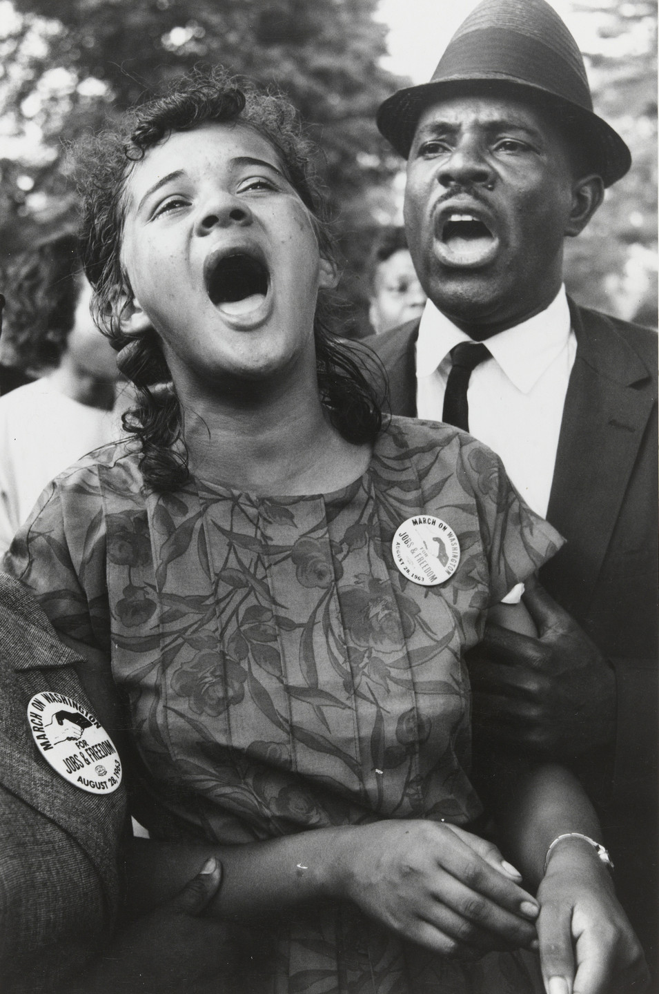 "Leonard Freed. Washington, D.C.: Demonstrators sing ""We Shall Overcome"" after Dr. Martin Luther King, Jr.'s ""I Have a Dream"" speech. August 28, 1963"
