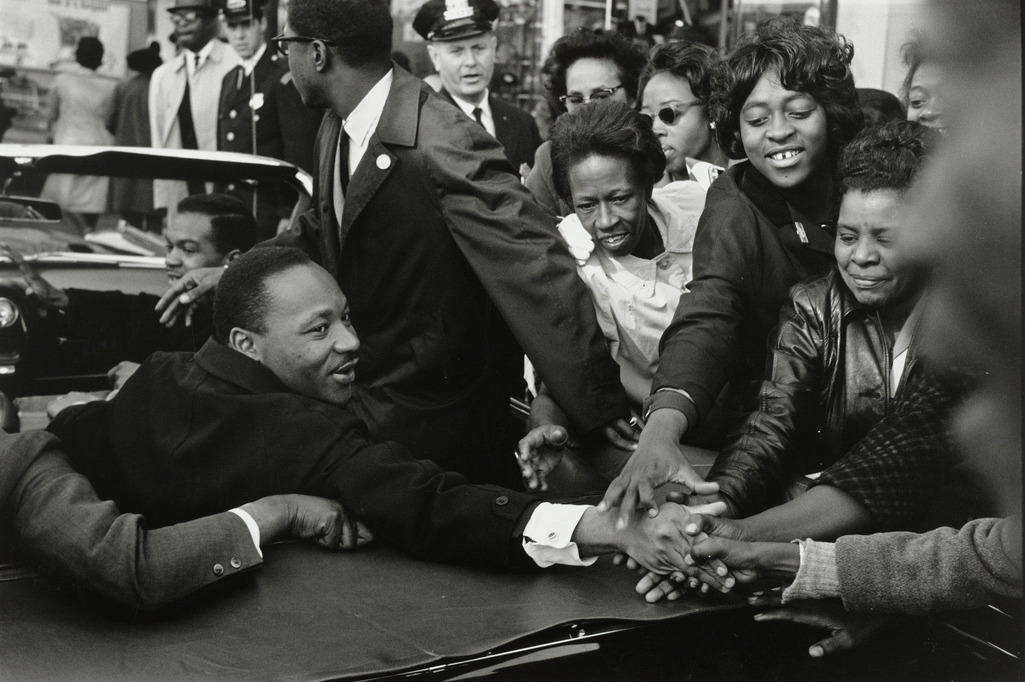 Leonard Freed. Baltimore, Maryland: Dr. Martin Luther King, Jr. being greeted upon his return to the United States after receiving the Nobel Peace Prize. October 31, 1964