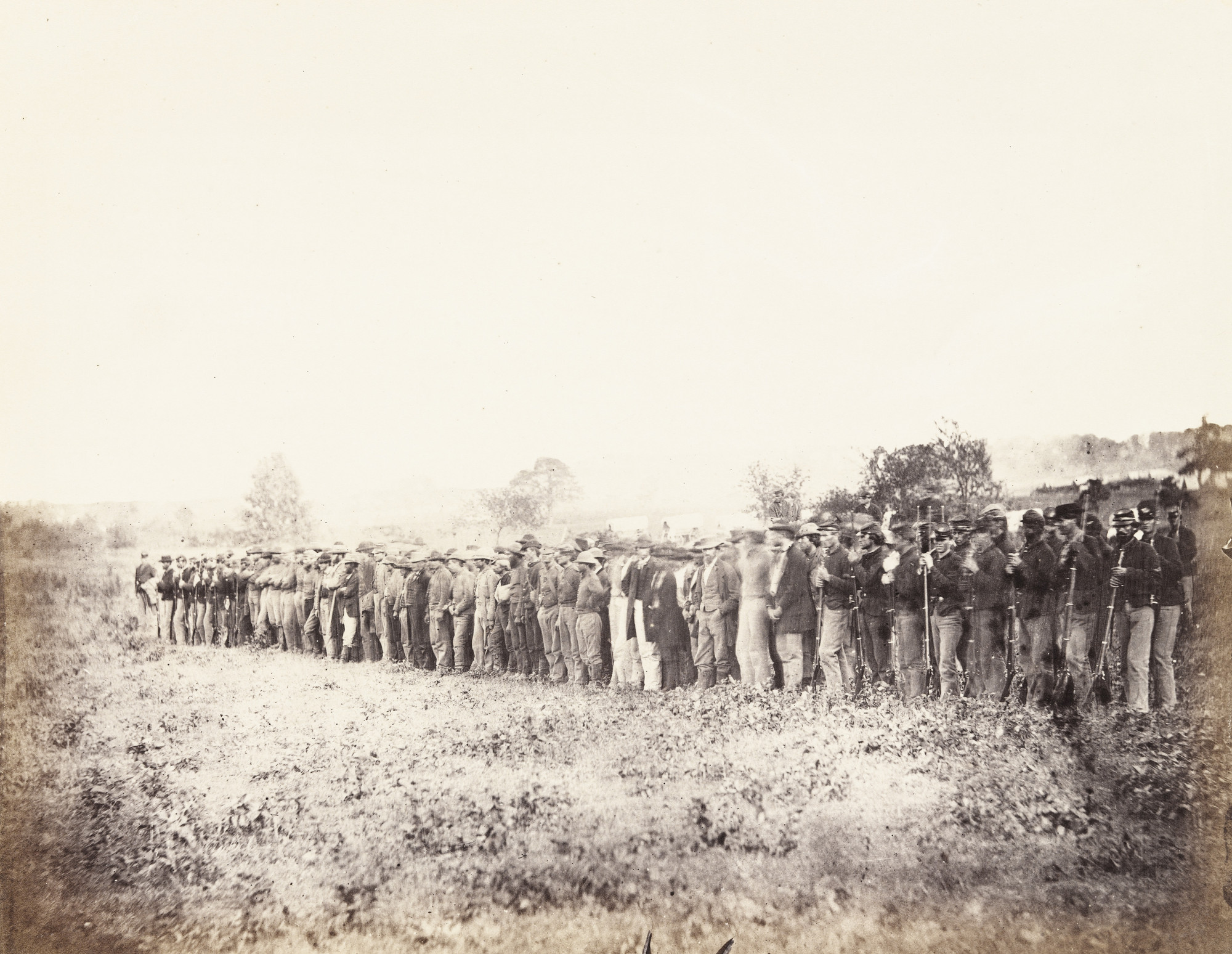 Alexander Gardner, Timothy O'Sullivan. Group of Confederate Prisoners at Fairfax Court-House. June, 1863