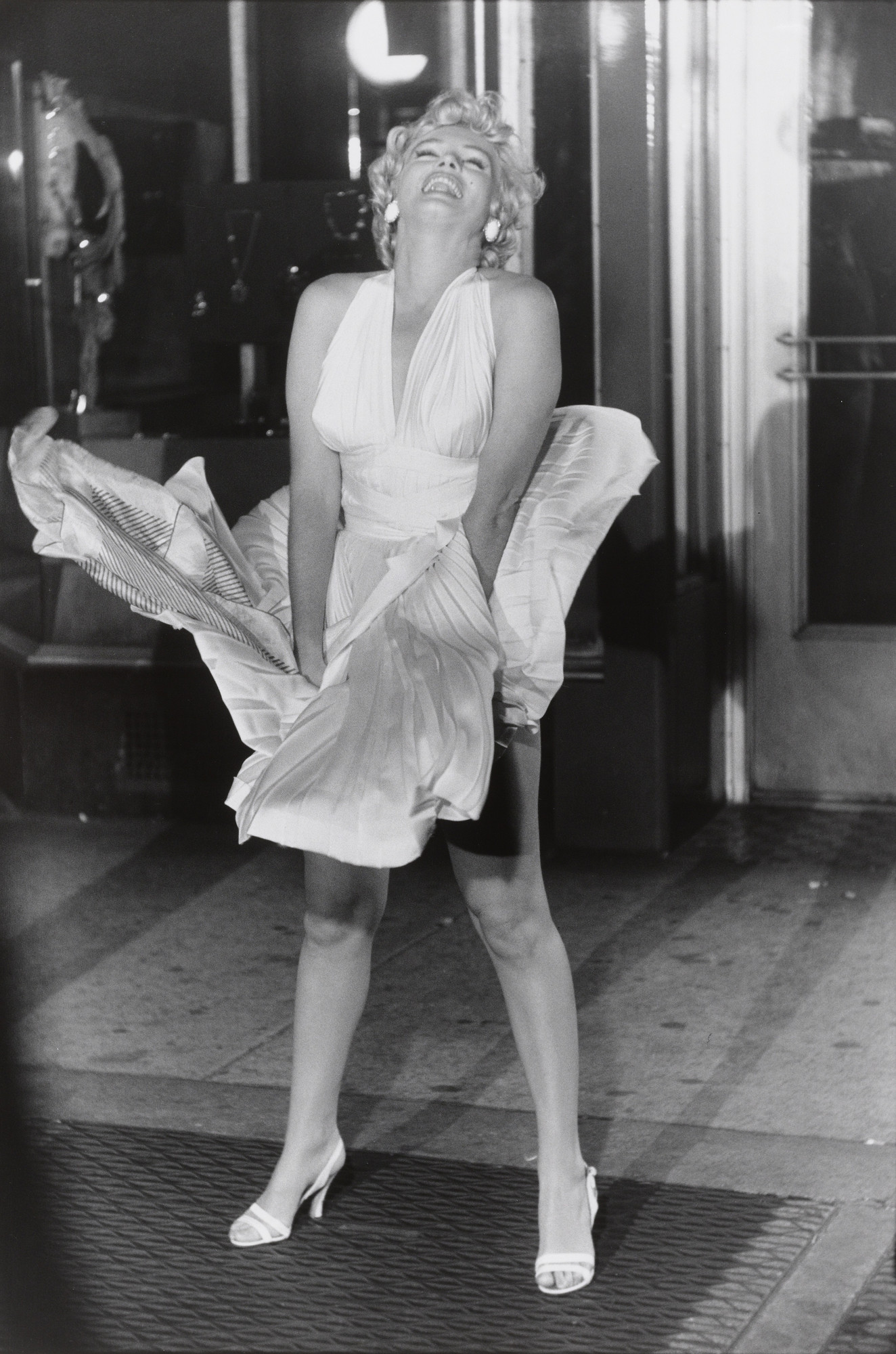 "Garry Winogrand. Marilyn Monroe, ""Seven Year Itch"" set, New York City from the portfolio Big Shots. 1955"