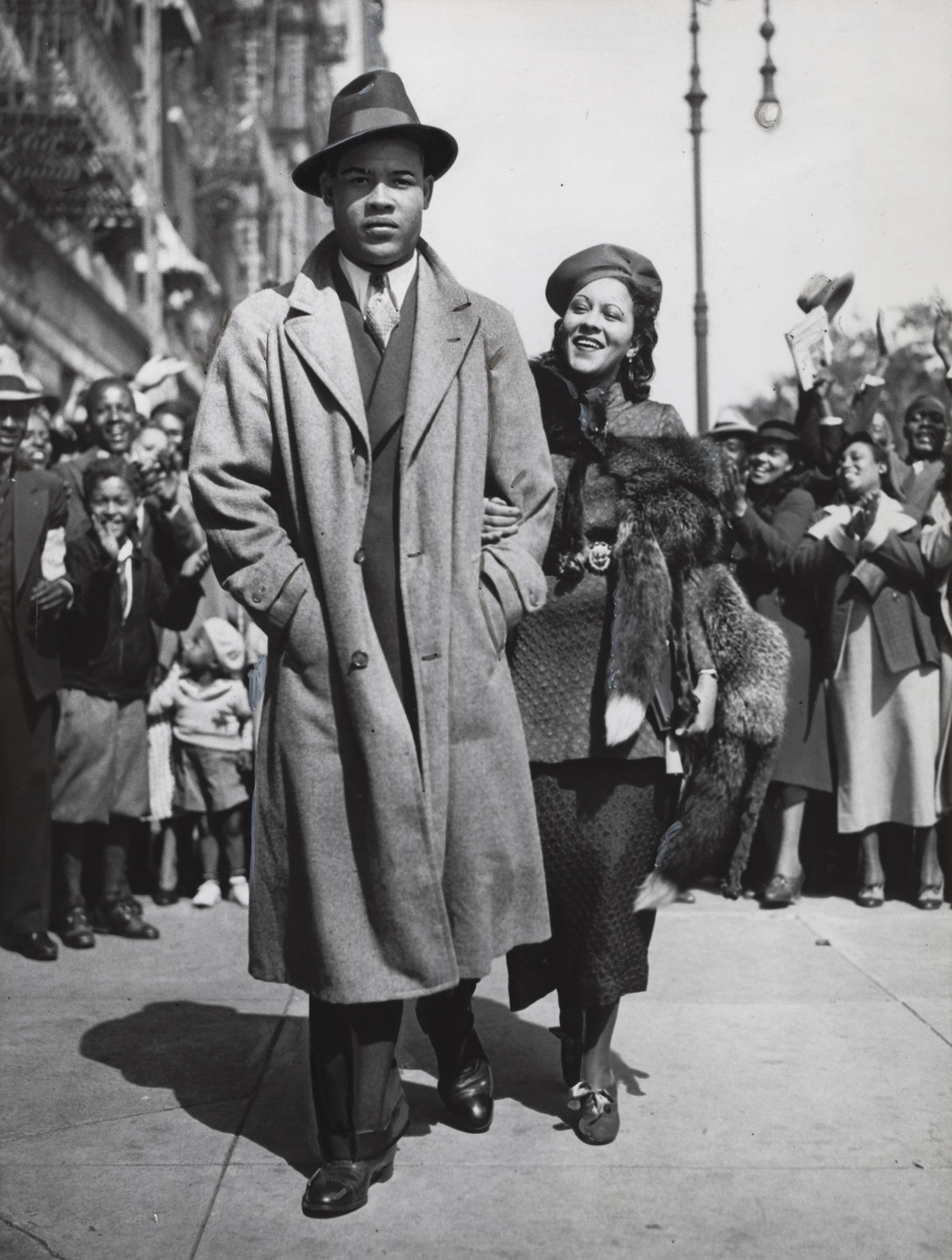 Times Wide World Photos. Mr. and Mrs. Joe Louis Out for a Stroll. September 25, 1935