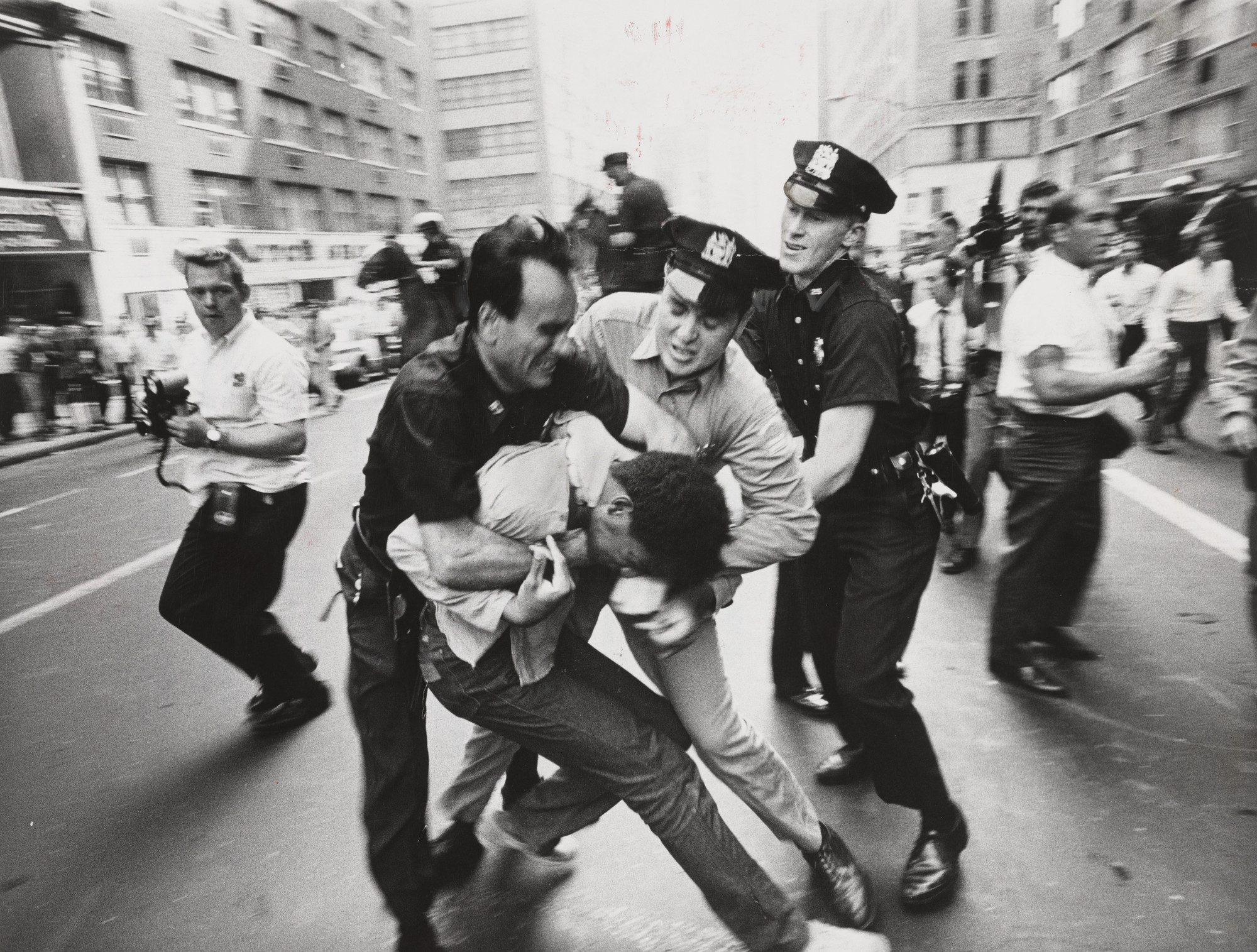 Don Hogan Charles/The New York Times. Policemen Scuffling with Demonstrator  Outside Armory. August 3, 1968 | MoMA