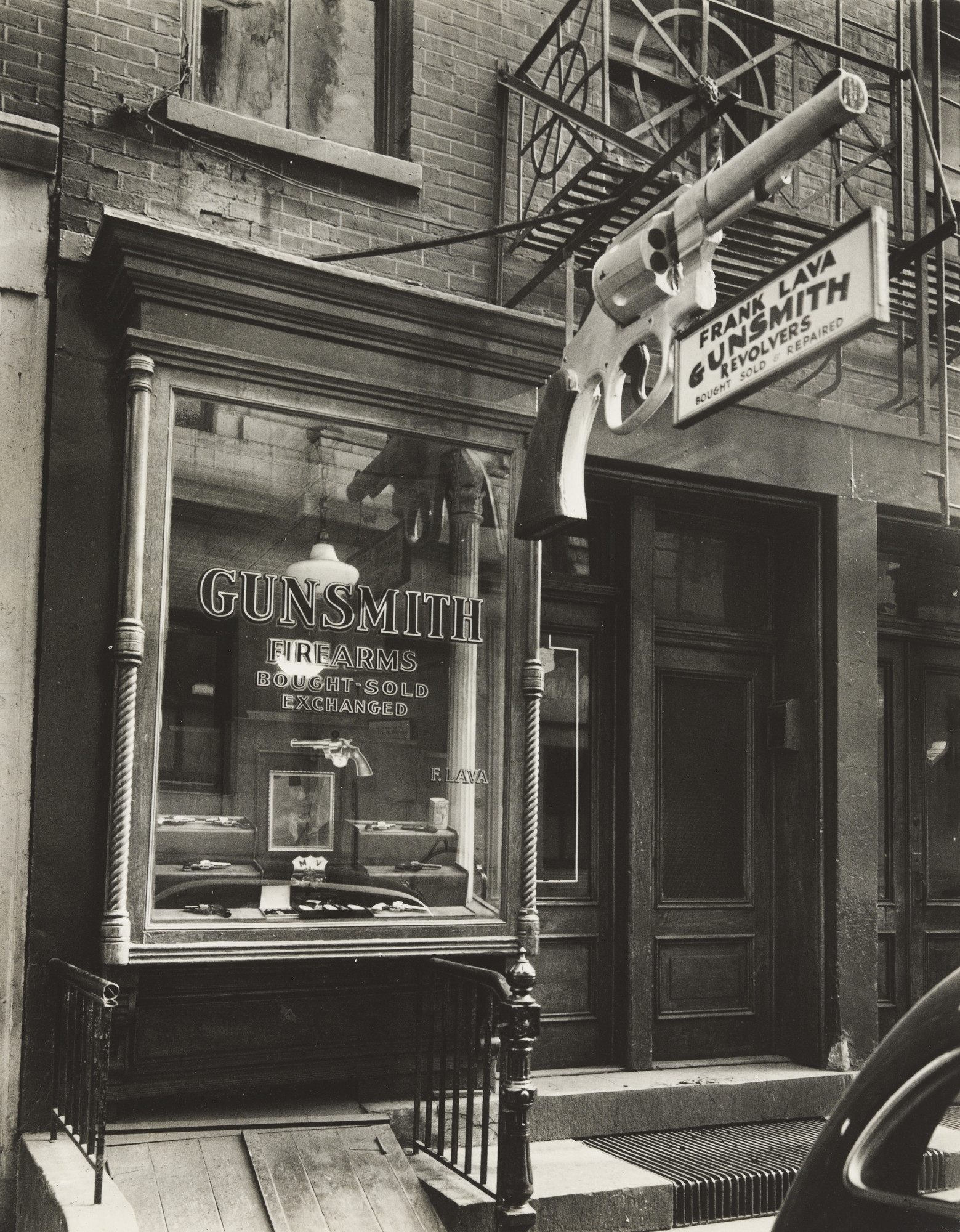 Berenice Abbott. Gunsmith, 6 Centre Market Place, Manhattan. February 4, 1937