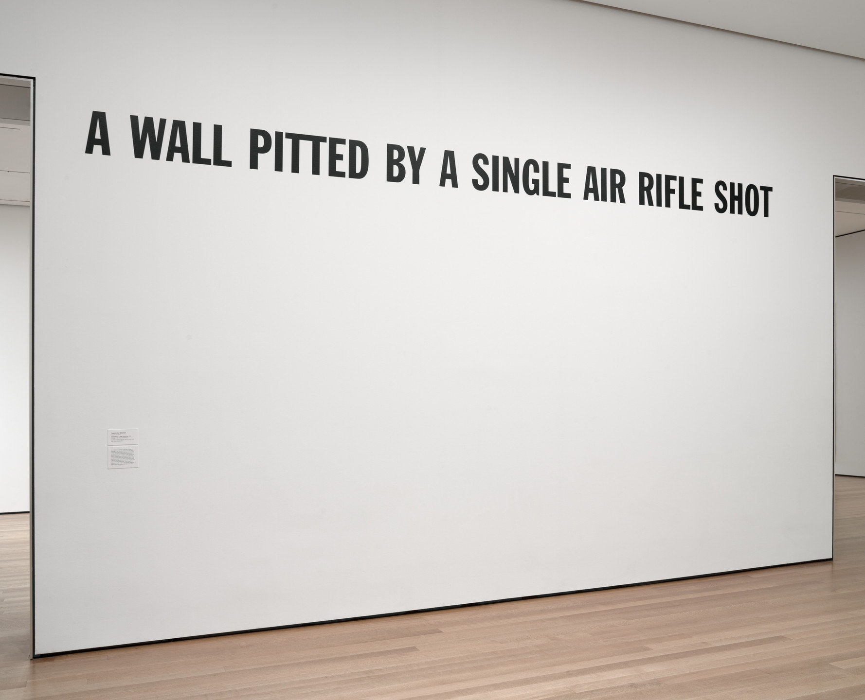 Lawrence Weiner. A WALL PITTED BY A SINGLE AIR RIFLE SHOT. 1969