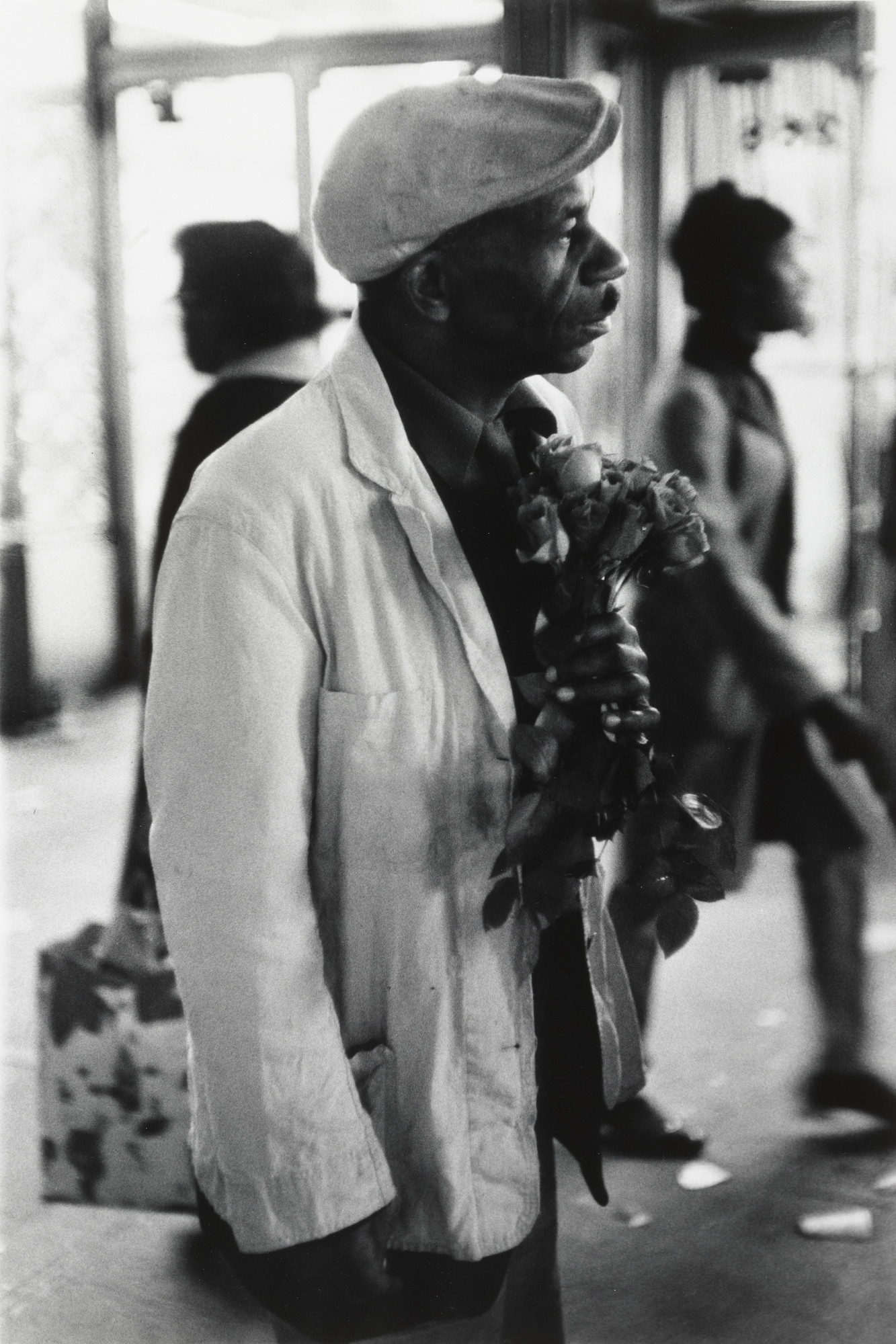 Beuford Smith. Man with Roses, 125th. St. NYC. 1968