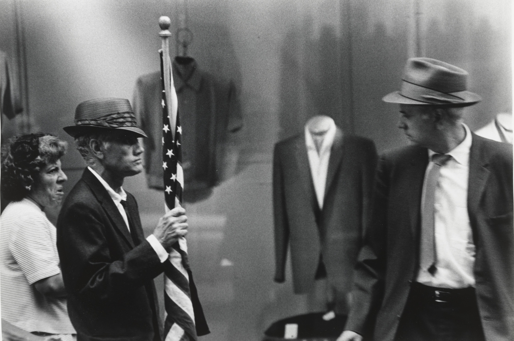 Beuford Smith. Man with Flag, Times Square, NYC. 1967