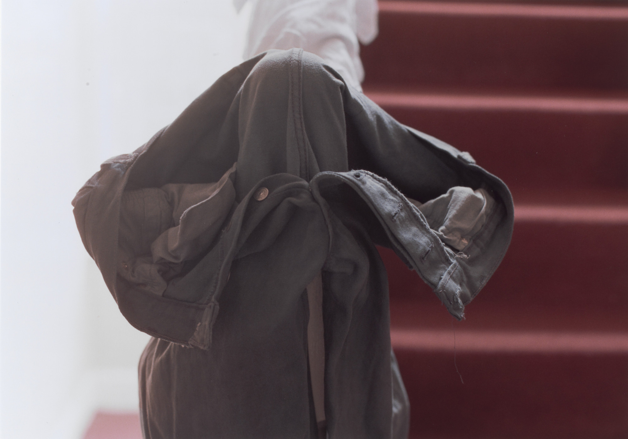 Wolfgang Tillmans. grey jeans over stair post. 1991