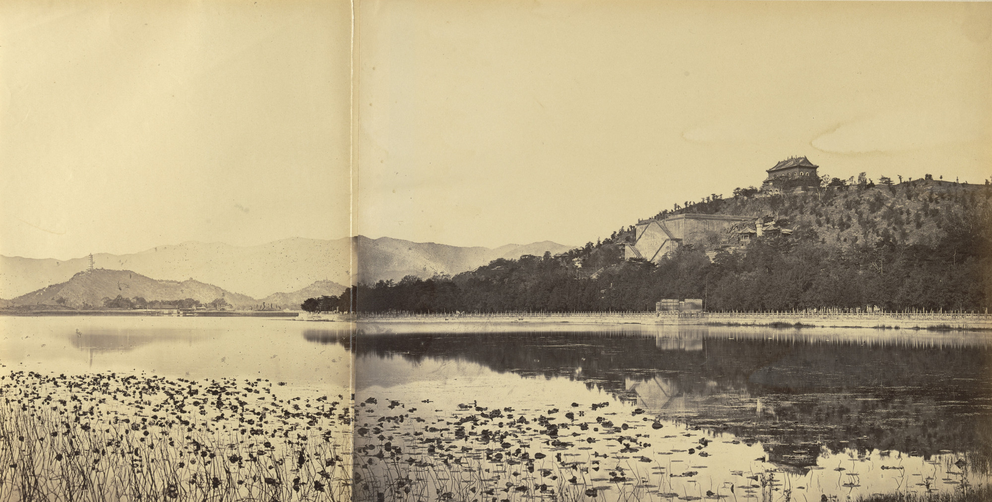 Felice Beato. View of the Imperial Summer Palace Yuen Ming Yuen After the Burning, Taken from the Lake, Peking. October 1860
