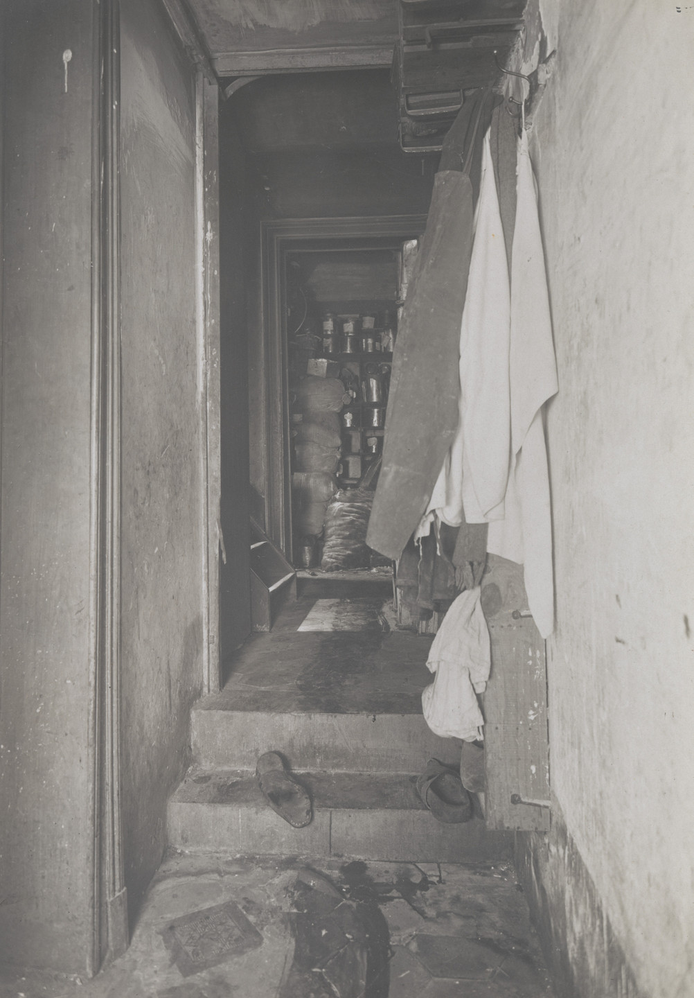 Unknown photographer. Untitled (crime scene: view down hall with shoes on steps). 1913