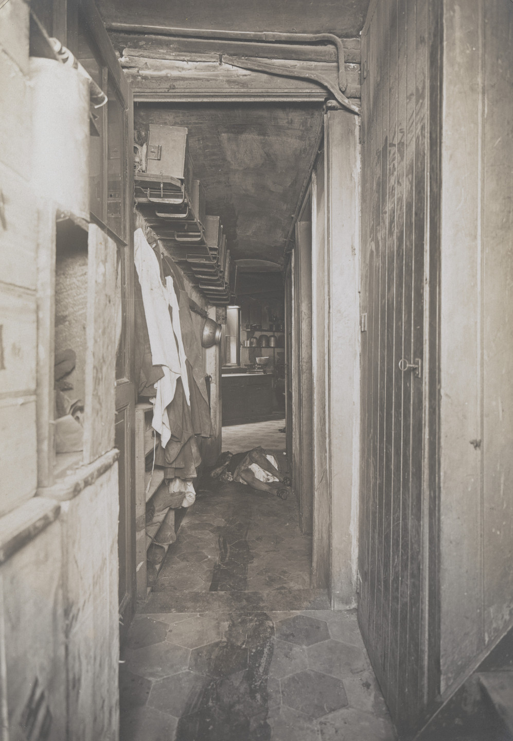 Unknown photographer. Untitled (crime scene: view down hall with body at end). 1913