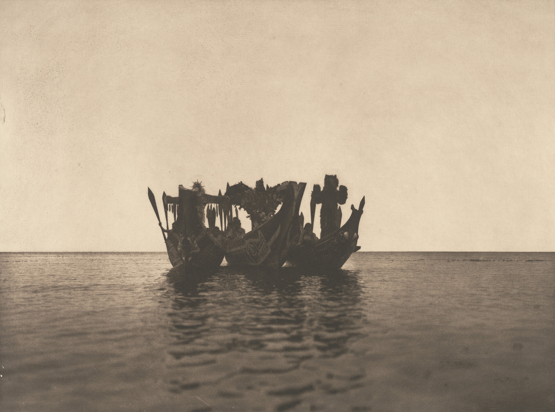Edward Curtis. Masked Dancers in Canoes, Qagyuhi. 1914