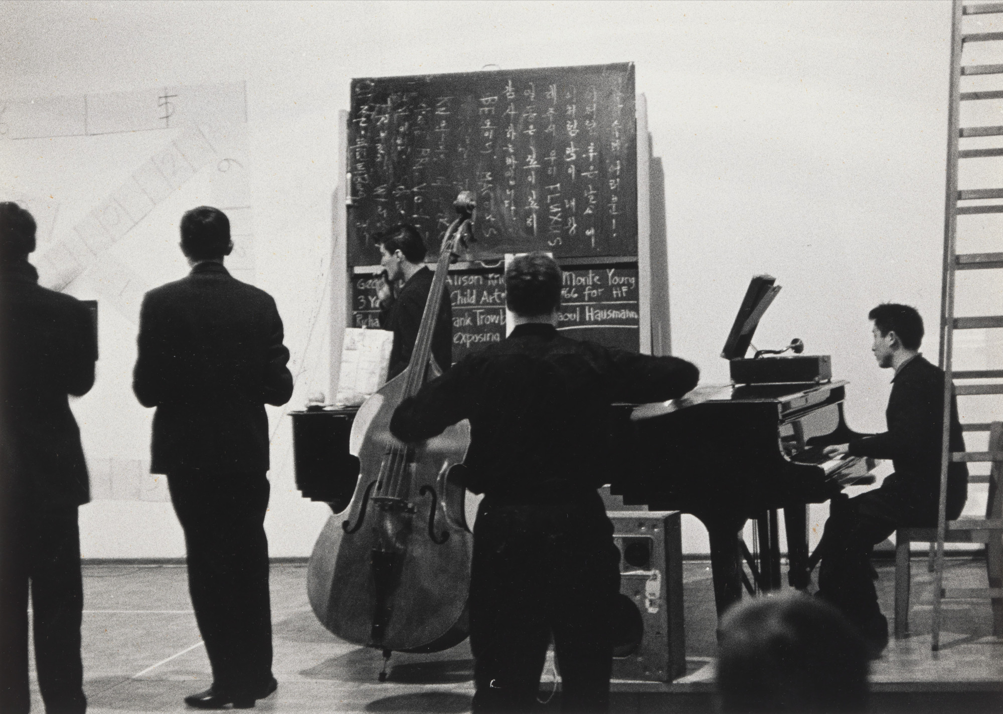 La Monte Young, Nam June Paik. Arabic Numeral (Any Integer) for Henry Flynt, and other simultaneous performances, performed during Festum Fluxorum/Fluxus/Musik und Antimusik/Das Instrumentale Theater, Staatliche Kunstakademie, Düsseldorf, February 2-3, 1963. 1963