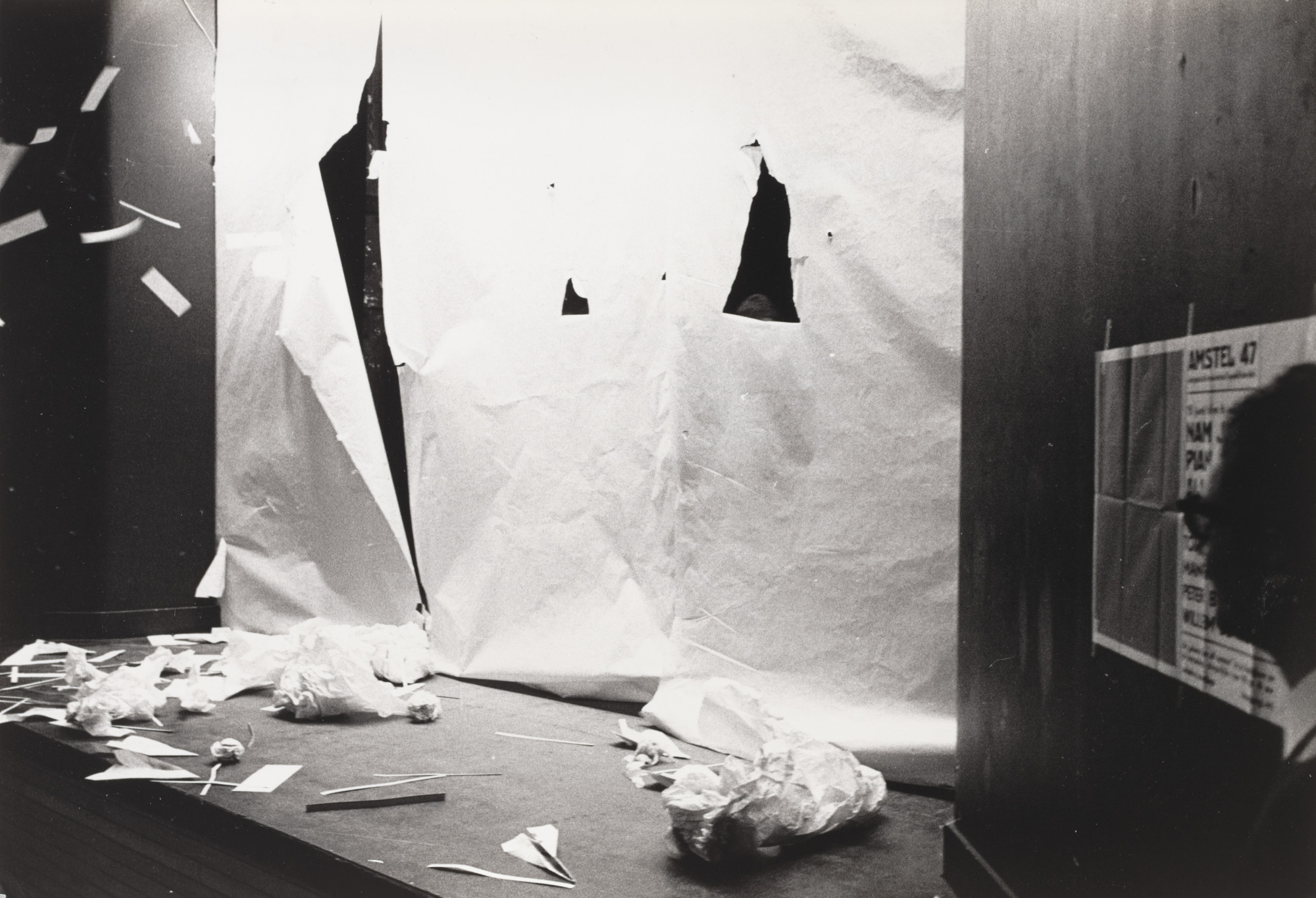 Benjamin Patterson, Oscar van Alphen. Paper Piece (1960), performed during Fluxus Festival/Theatre Compositions/Street Compositions/Exhibits/Electronic Music, Hypokriterion Theater, Amsterdam, June 23, 1963. 1963