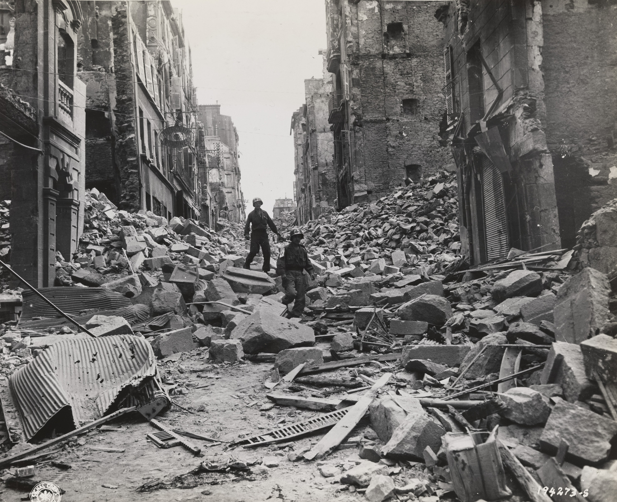 "U.S. Army Signal Corps. Untitled (""Two army first aid men search through the wreckage in the streets of Brest, France, for injured""). September 19, 1944"