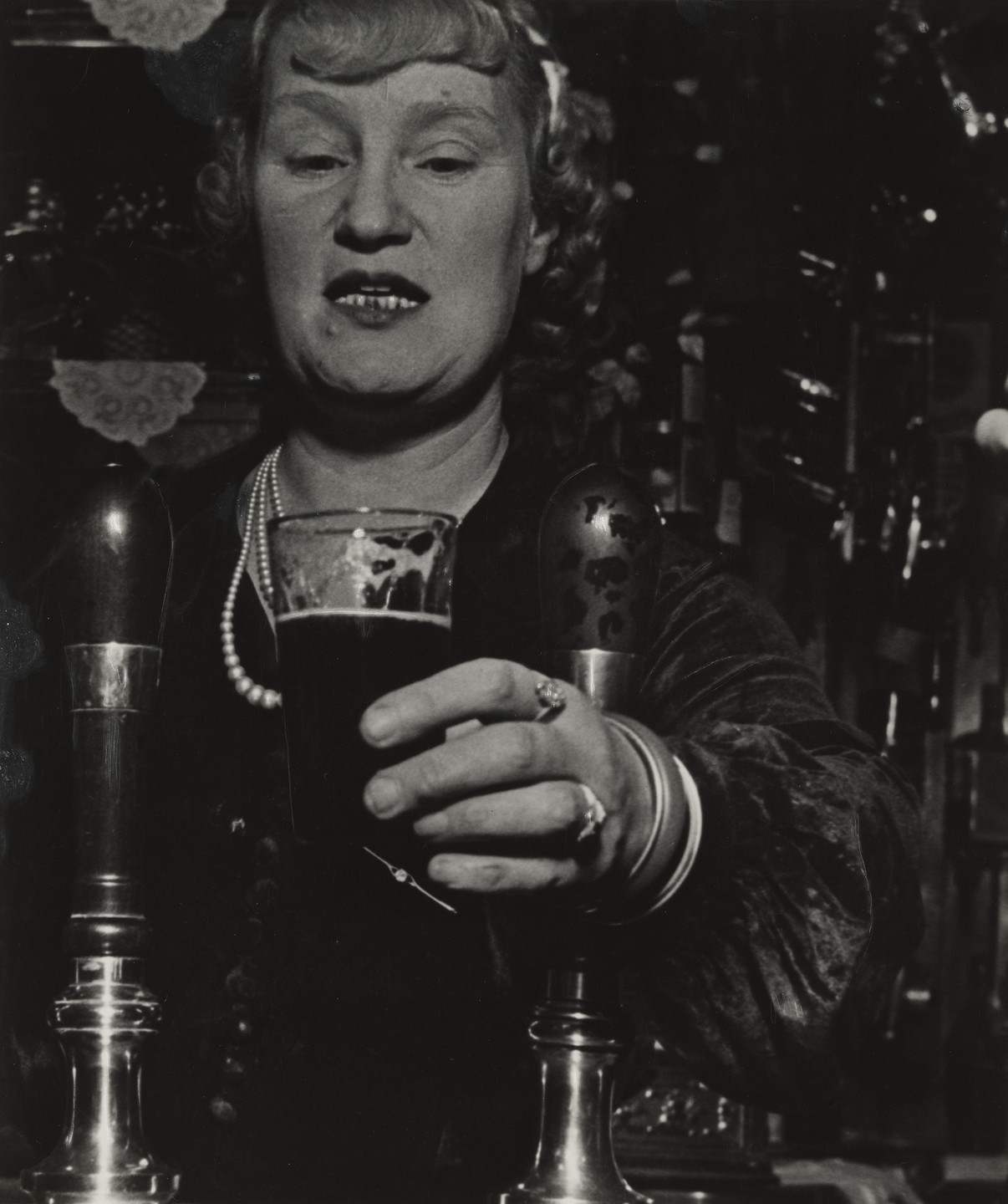 Bill Brandt. Barmaid at the Crooked Billet, Tower Hill. 1939
