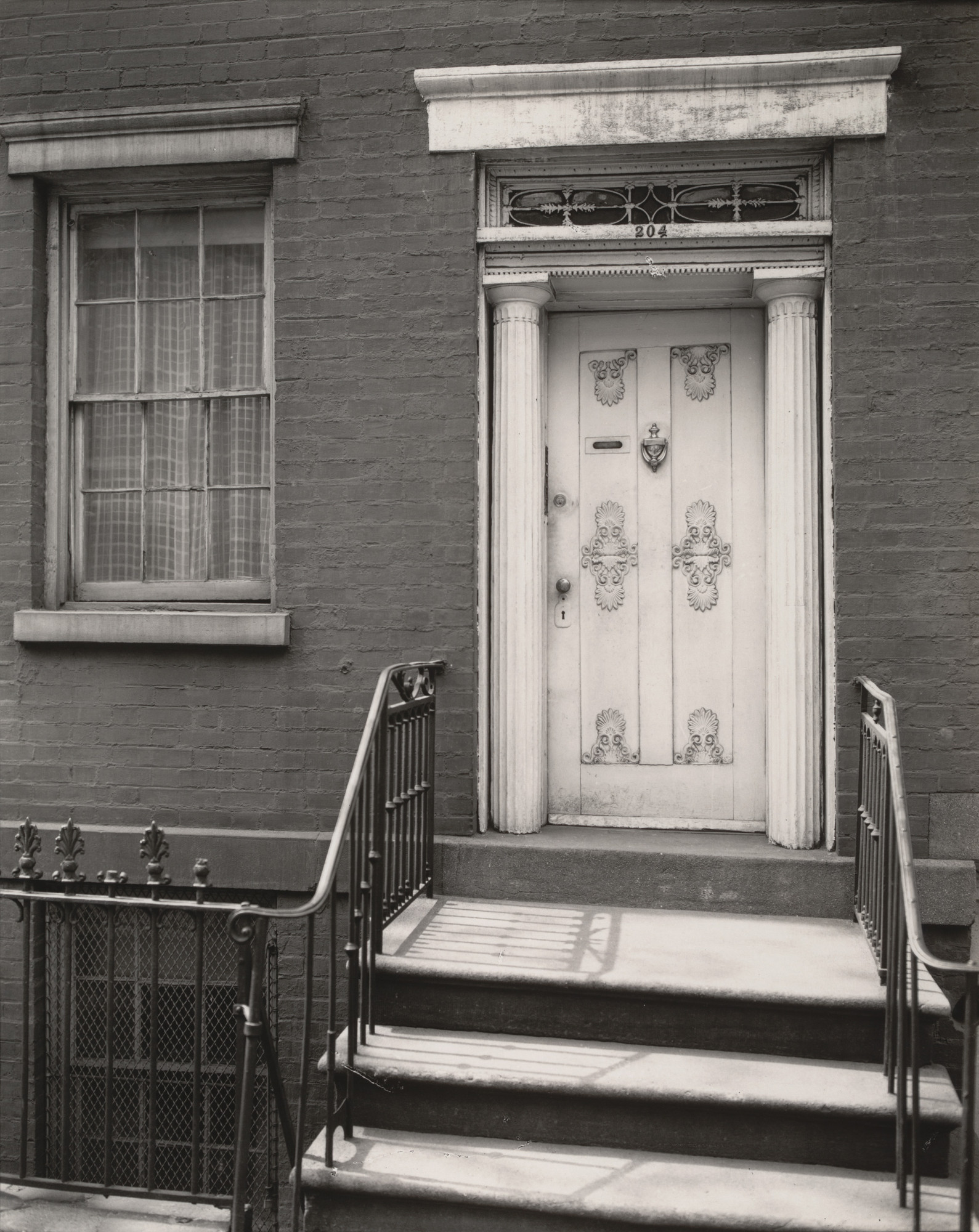 Berenice Abbott. Doorway, 204 West 13th Street, Manhattan. May 5, 1937