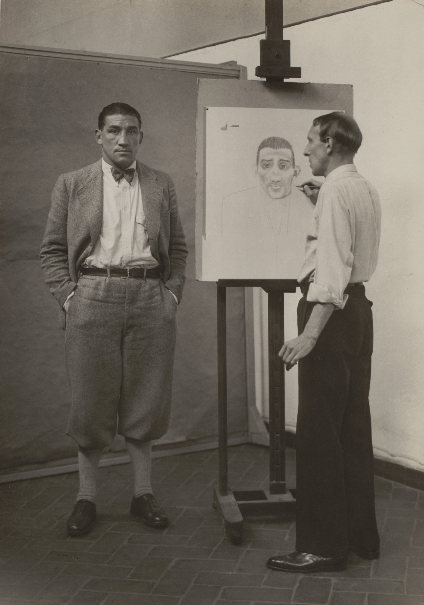 August Sander. The Painter Heinrich Hörle Drawing the Boxer Hein Domgören. 1927-31