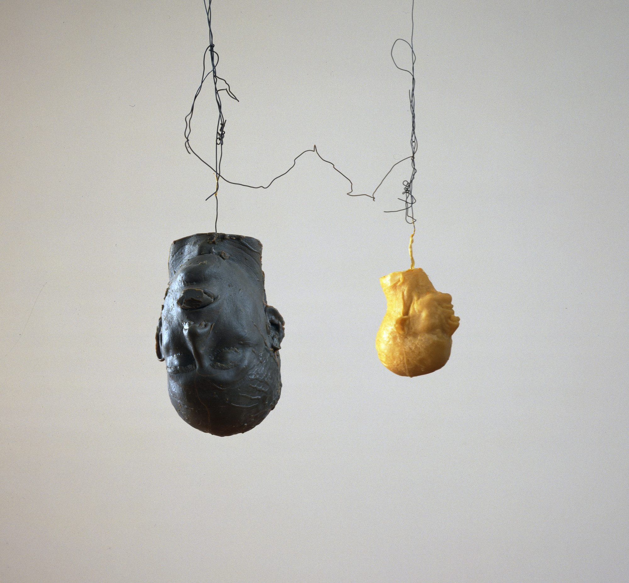 Bruce Nauman. Hanging Heads #2 (Blue Andrew with Plug/White Julie, Mouth Closed). 1989