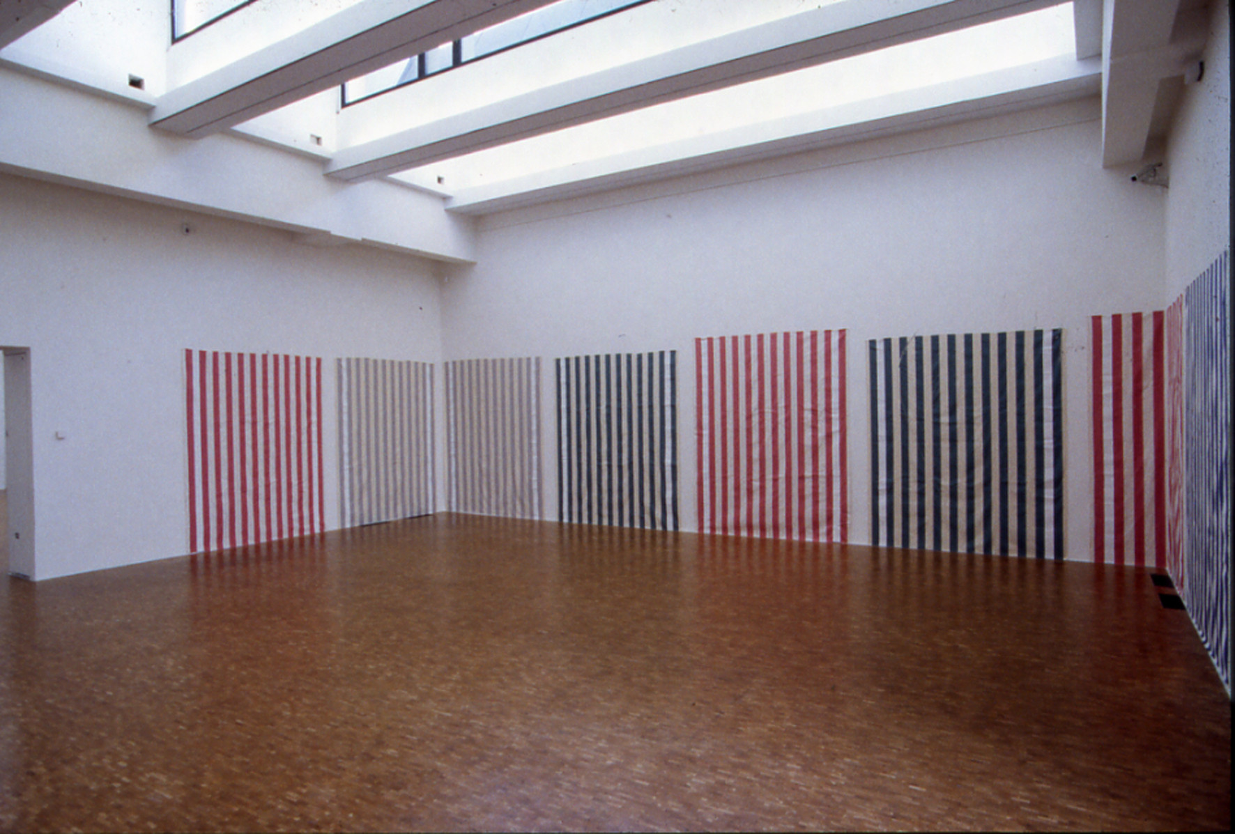 Daniel Buren. Striped cotton fabric with vertical white and colored bands of 8,7cm (+/– 0,3 cm) each. The two external white bands covered over with acrylic white paint recto-verso, [Tissu en coton rayé de bandes verticales blanches et colorées de 8,7cm (+/– 0,3 cm) chacune. Les deux bandes extrêmes blanches recouvertes de peinture acrylique blanche recto-verso]. 1970