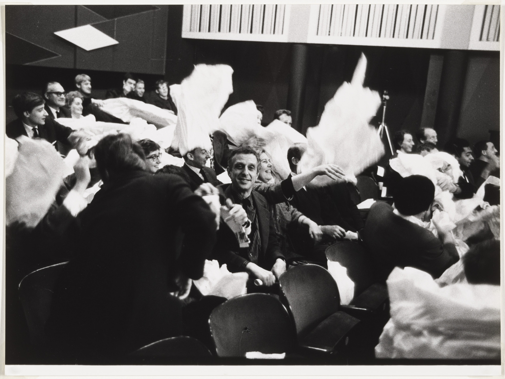 Benjamin Patterson. Audience members participating in Paper Piece (1960), performed during Fluxus Festival/Theatre Compositions/Street Compositions/Exhibits/Electronic Music, Hypokriterion Theater, Amsterdam, June 23, 1963. 1963