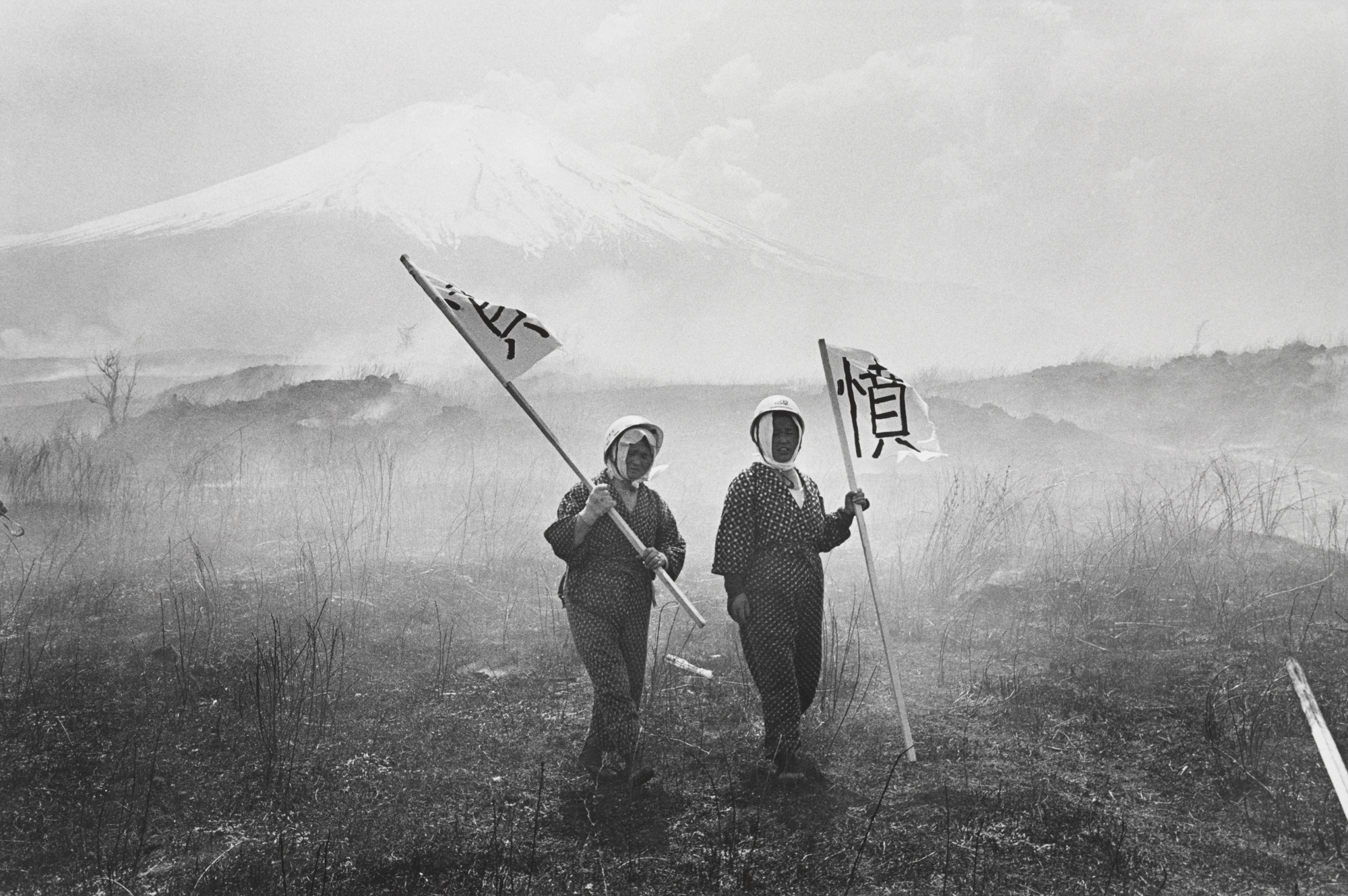Ryoji Akiyama. Two Lady Farmers in an Anti-War Demonstration Forcing Their Way into the U.S. Army Maneuver Area at the Foot of Mt. Fuji. 1971