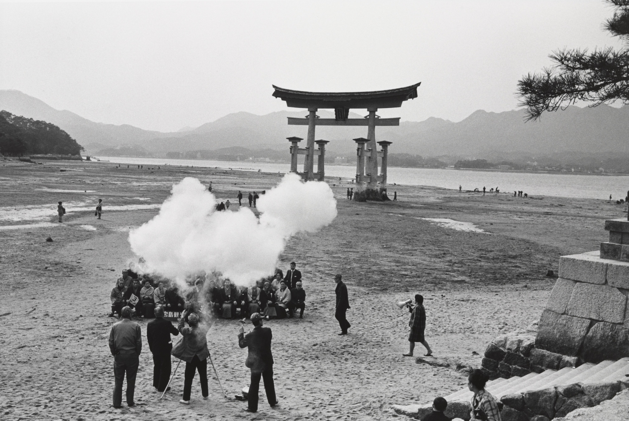 Ryoji Akiyama. Tourists Being Photographed in Front of a Tori, Miyajima. 1970