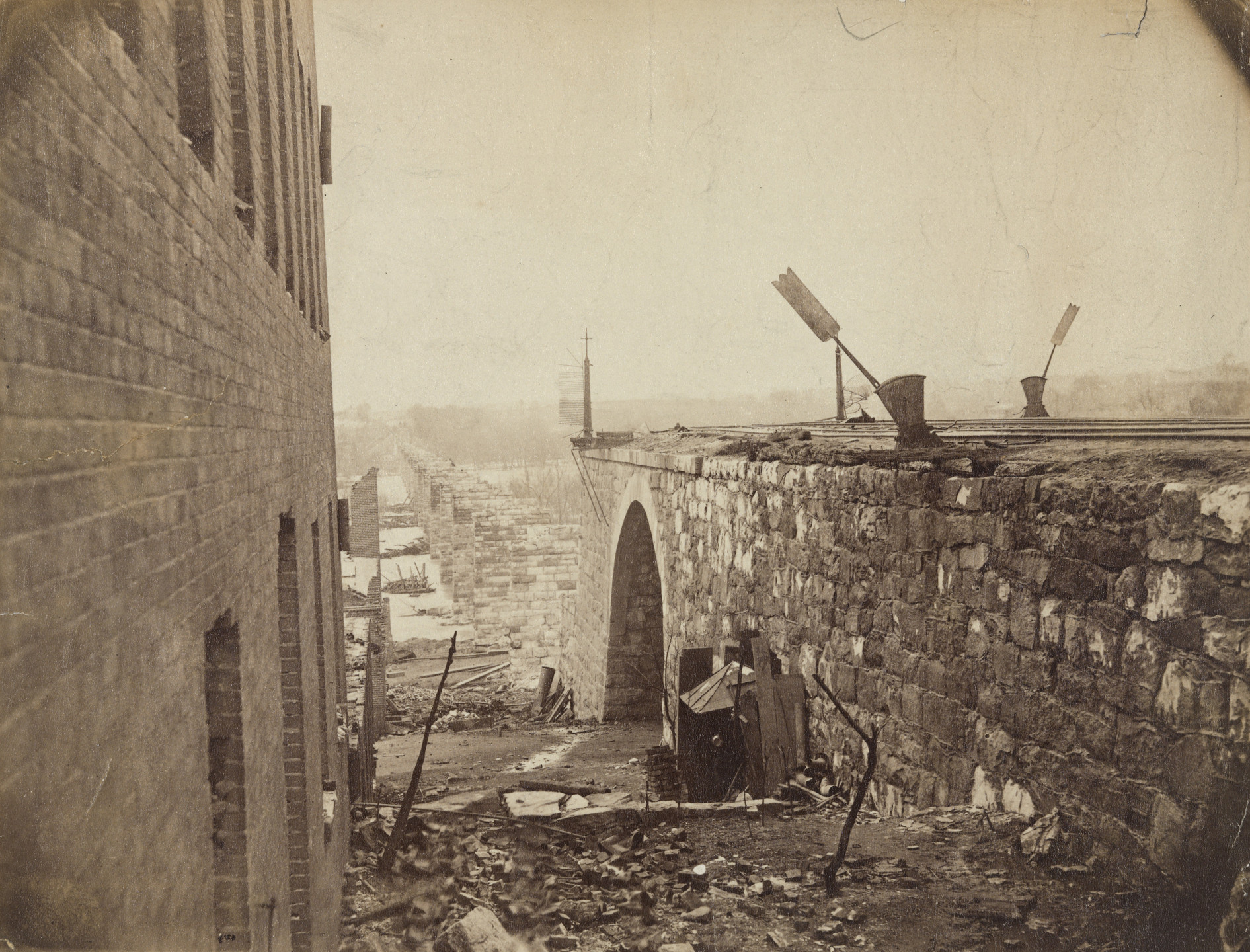 Mathew B. Brady (studio of). Ruins of Richmond & Petersburg Railroad Bridge, Richmond, Virginia. April 1865