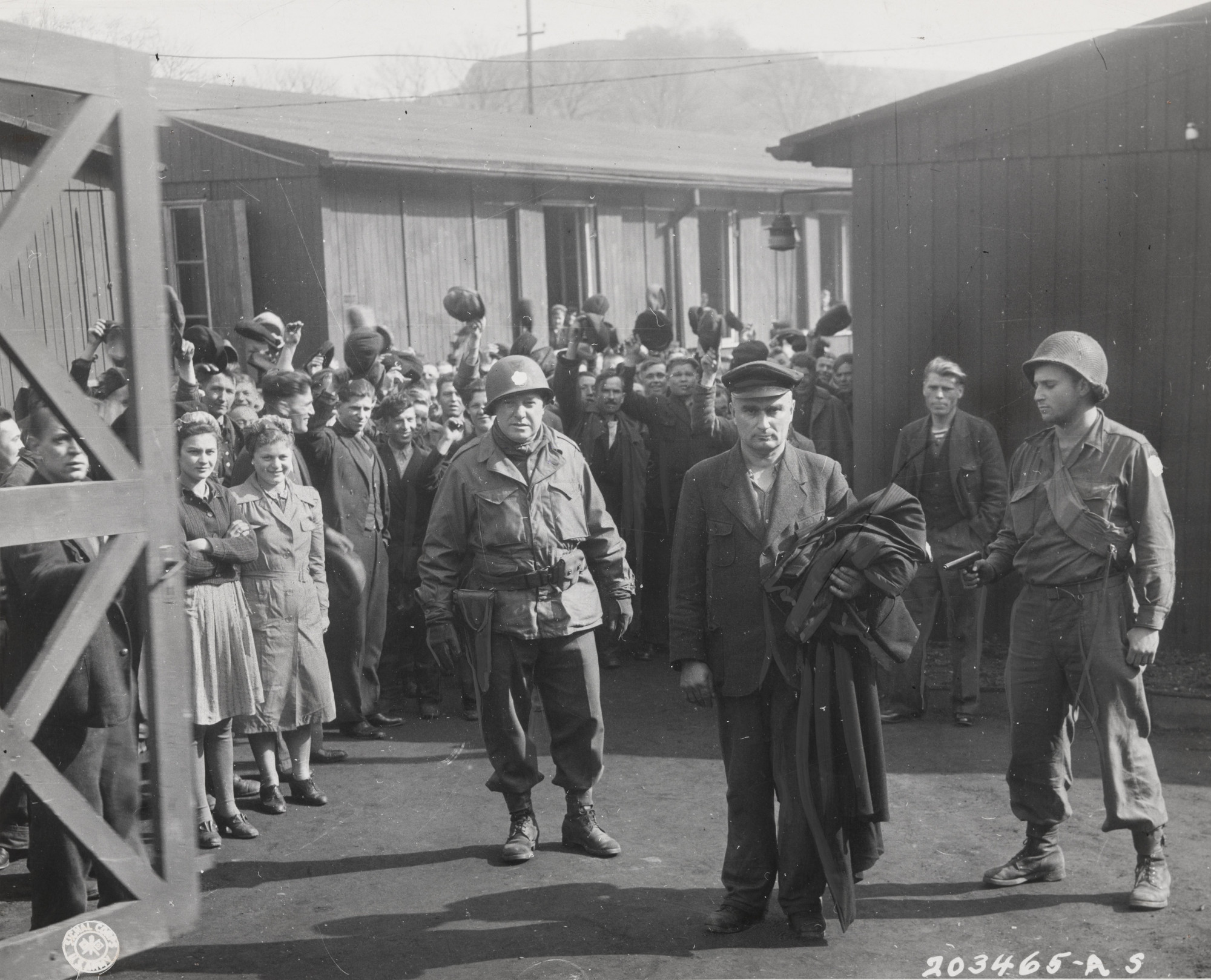 "U.S. Army Signal Corps. ""Major Anthony Malankowski and Private Arthur Fields Lead Away the Commandant of Altendorn Camp"". April 13, 1945"