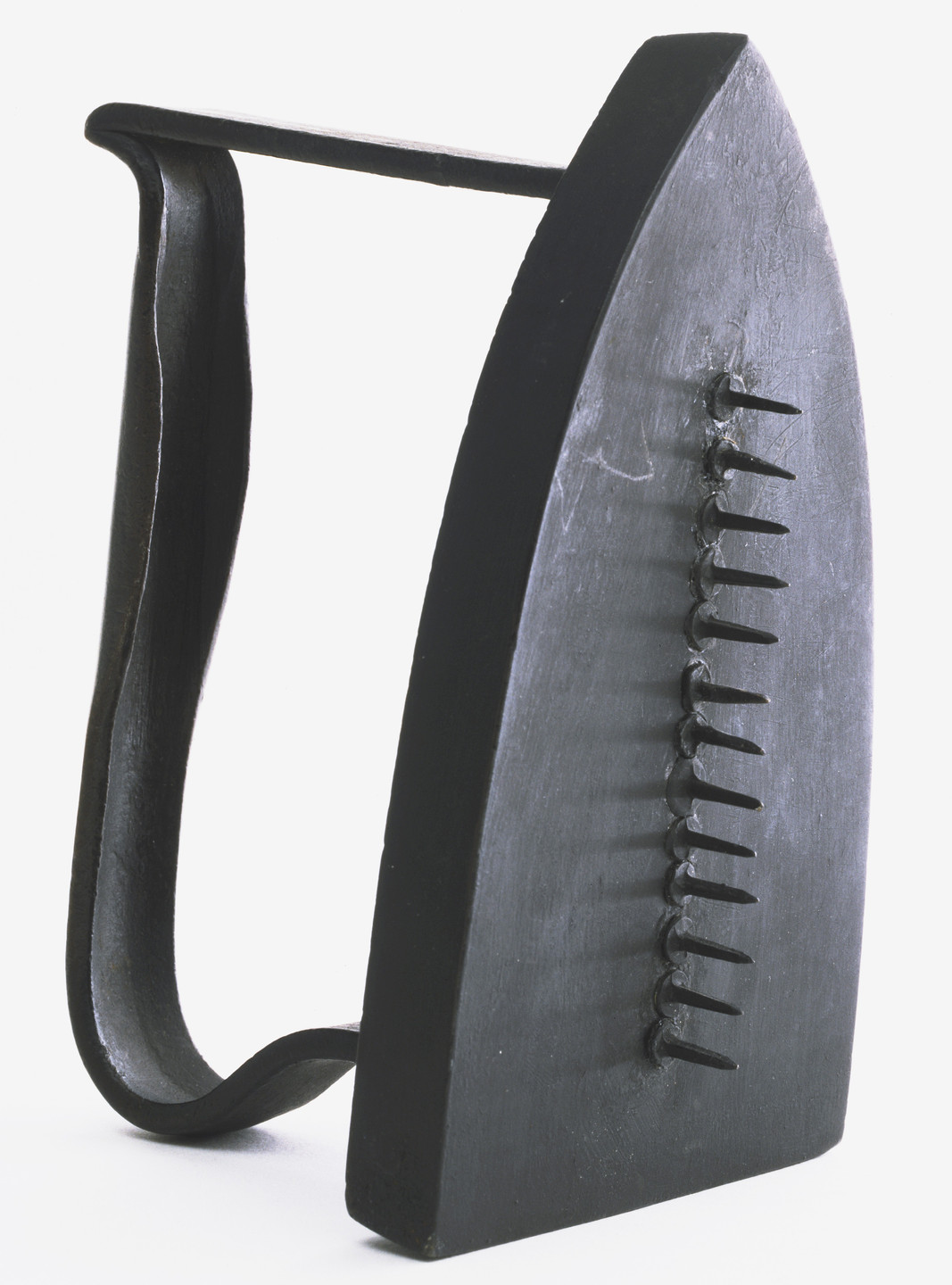 Man Ray (Emmanuel Radnitzky). Gift. c. 1958 (replica of 1921 original)