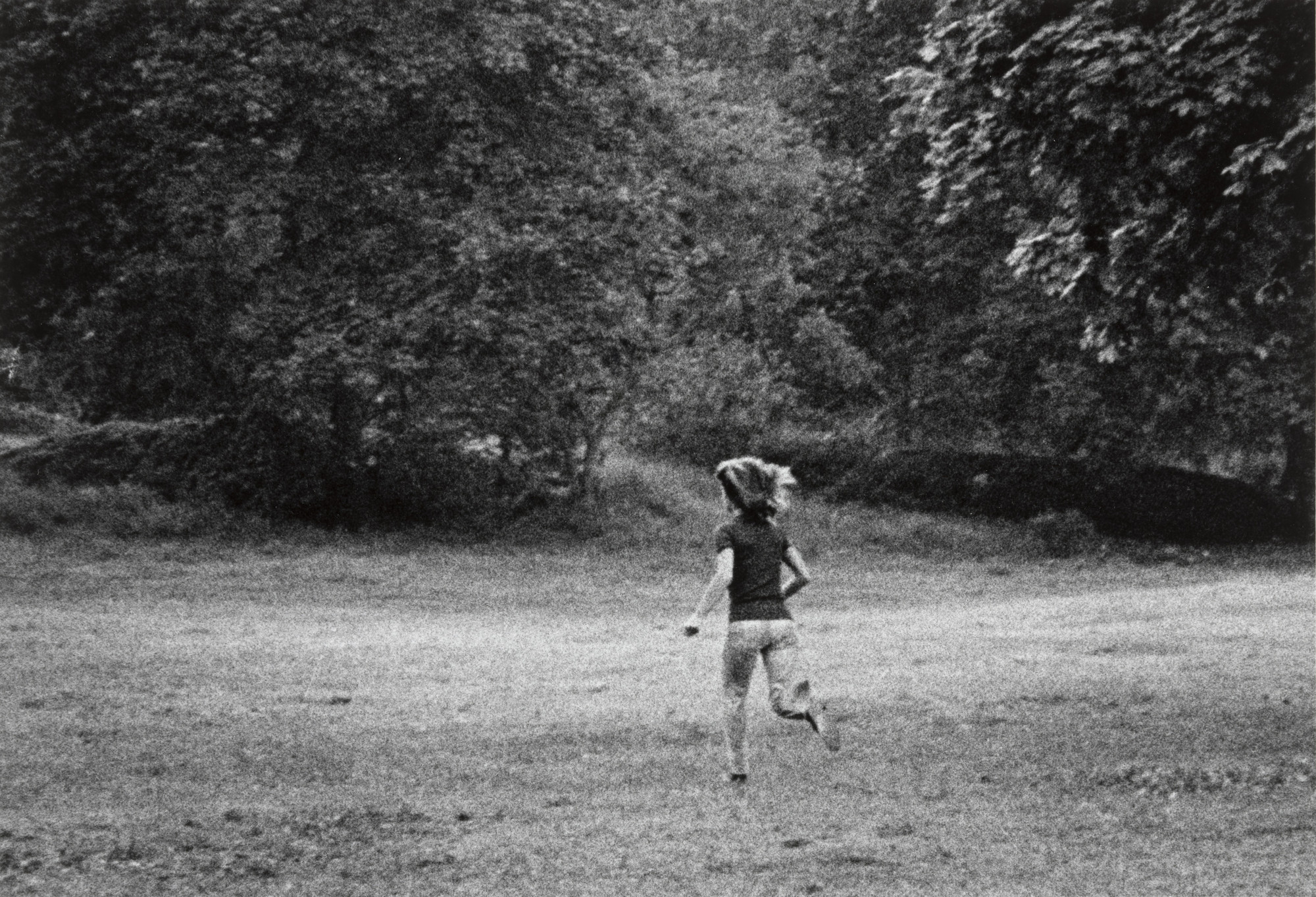 Ron Galella. Jackie Onassis Attempting to Distract Ron Galella from Photographing Her Daughter Caroline, Central Park, New York. October 4, 1971