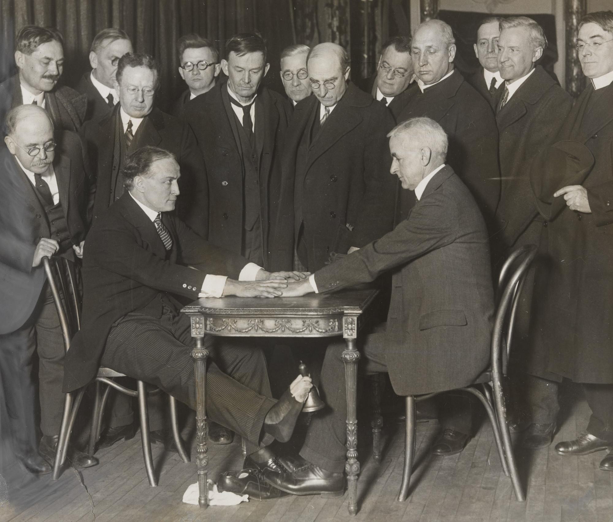 "Times Wide World Photos. ""Houdini Exposes Spirit Trickery to New York Clergymen"". February 3, 1925"