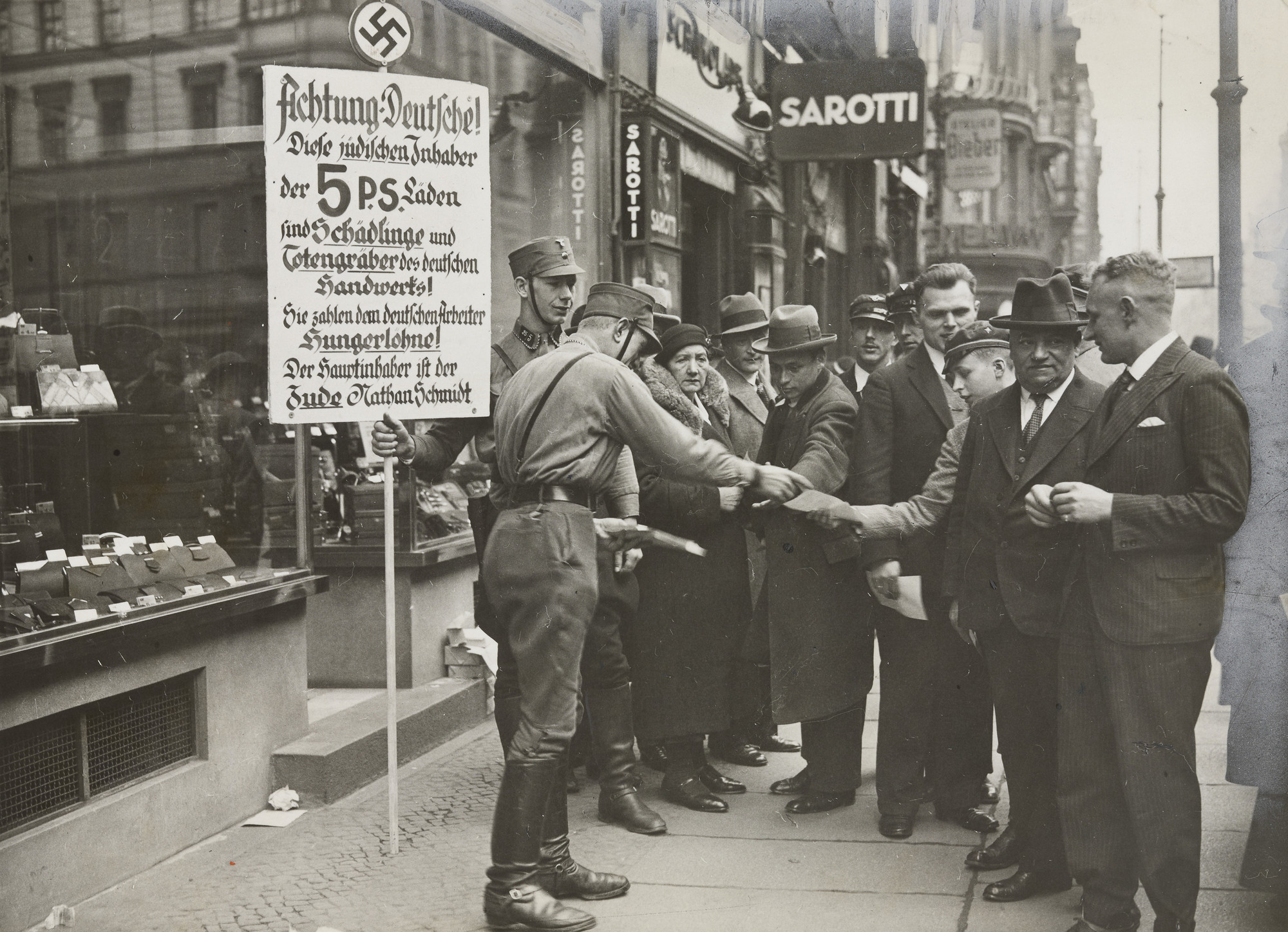 "Times Wide World Photos. ""How the Boycott Was Enforced: Nazi Guards"". 1933"