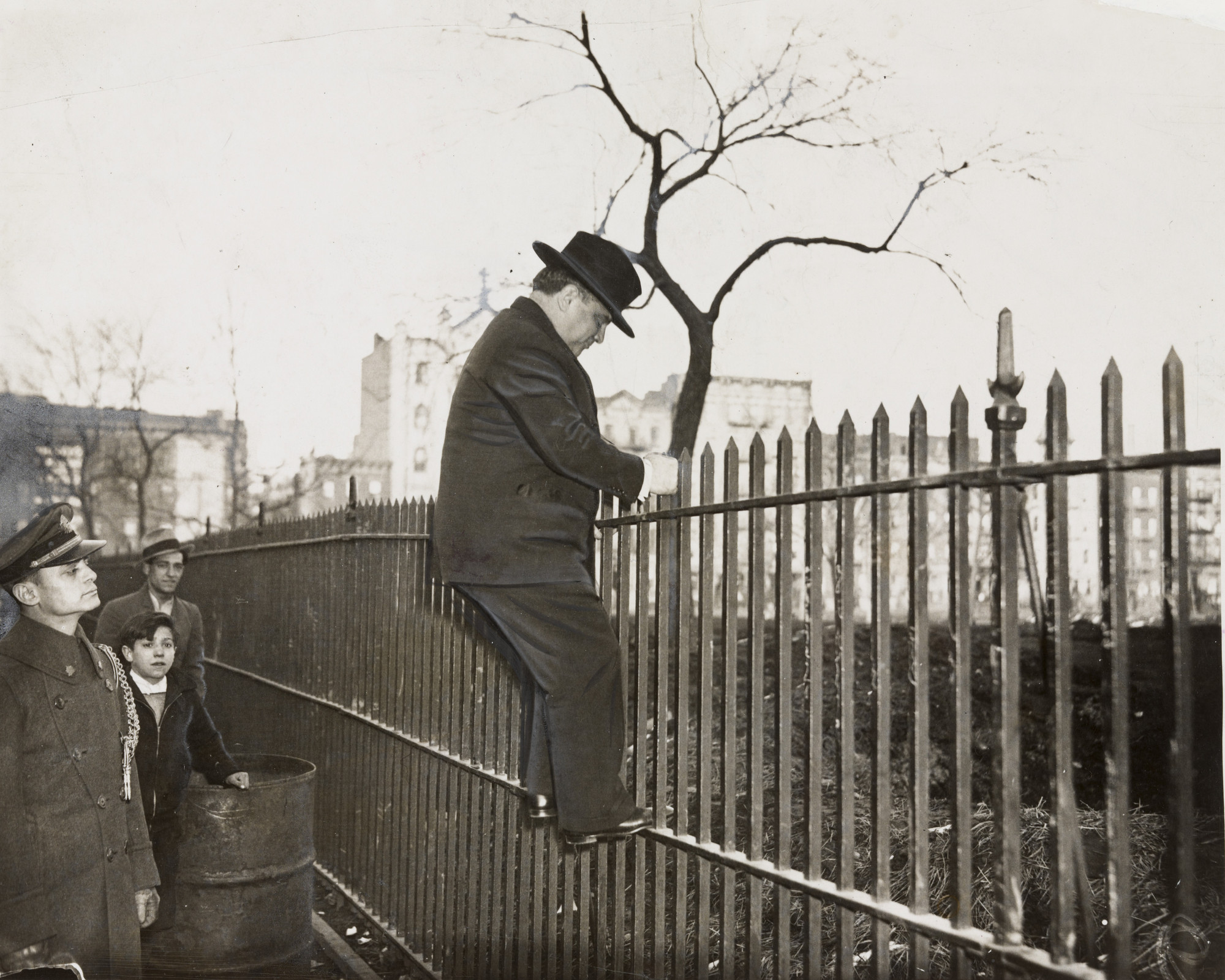 "Times Wide World Photos. ""Mayor La Guardia Climbs a Fence"". March 1935"