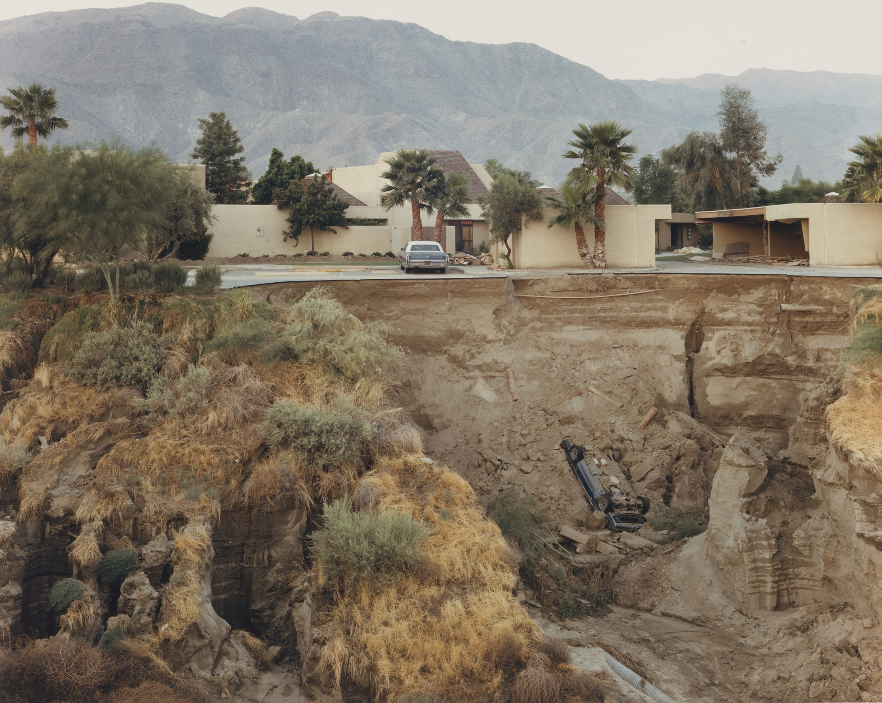 Joel Sternfeld. After a Flash Flood, Rancho Mirage, California. July 1979