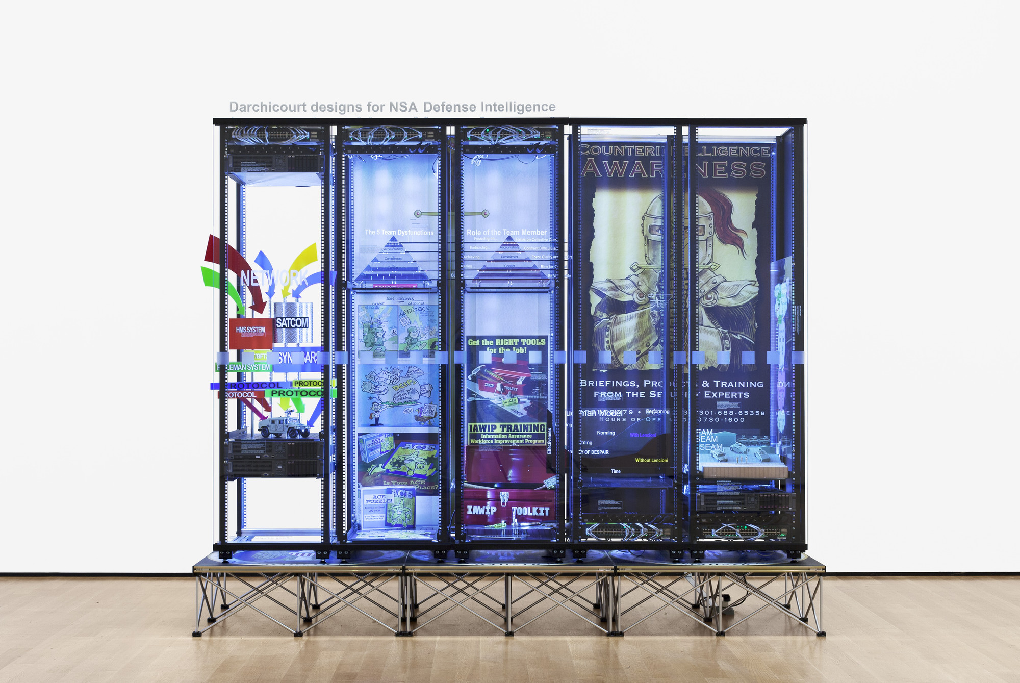 Simon Denny. Modded Server-Rack Display with Some Interpretations of David Darchicourt Designs for NSA Defense Intelligence. 2015