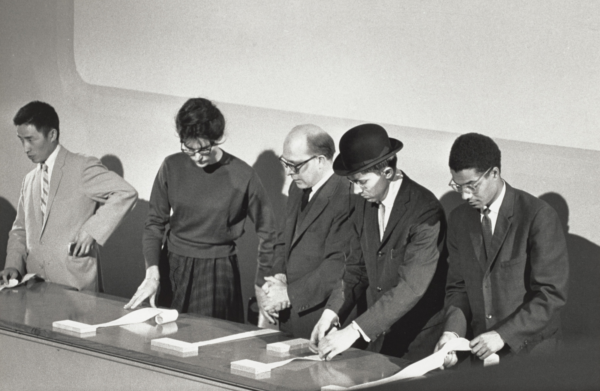 George Maciunas, Nam June Paik, Alison Knowles, Emmett Williams, George Maciunas, Benjamin Patterson. George Maciunas' In Memoriam to Adriano Olivetti, performed during Concert No. 5, Fluxus Internationale Festspiele Neuester Musik, Städtisches Museum, Wiesbaden, September 8, 1962. 1962