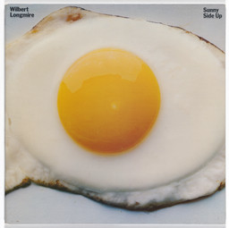 Paula Scher, John Paul Endress. Album cover for Wilbert Longmire, Sunny Side Up. 1978