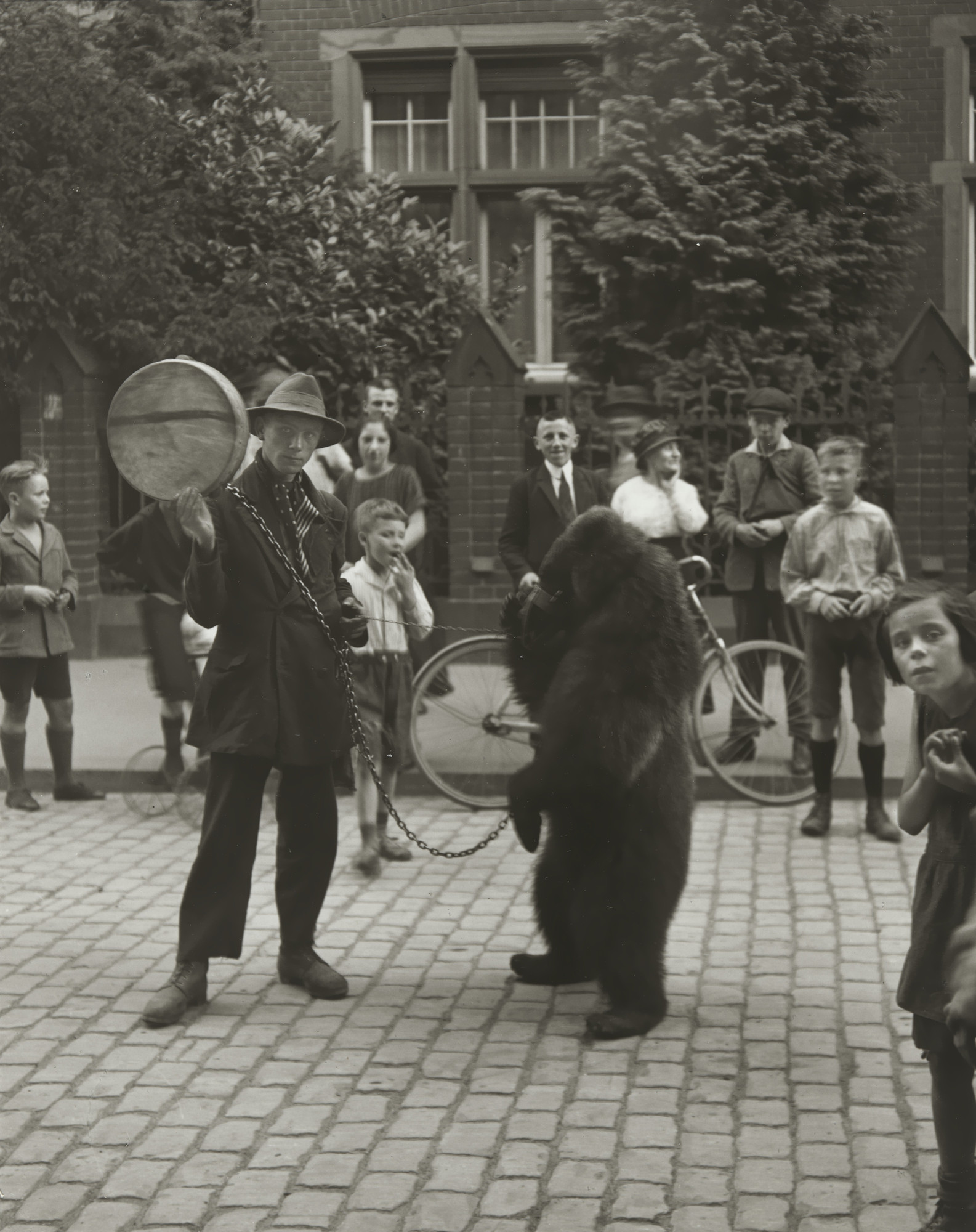 August Sander. Showman with Performing Bear in Cologne. 1923