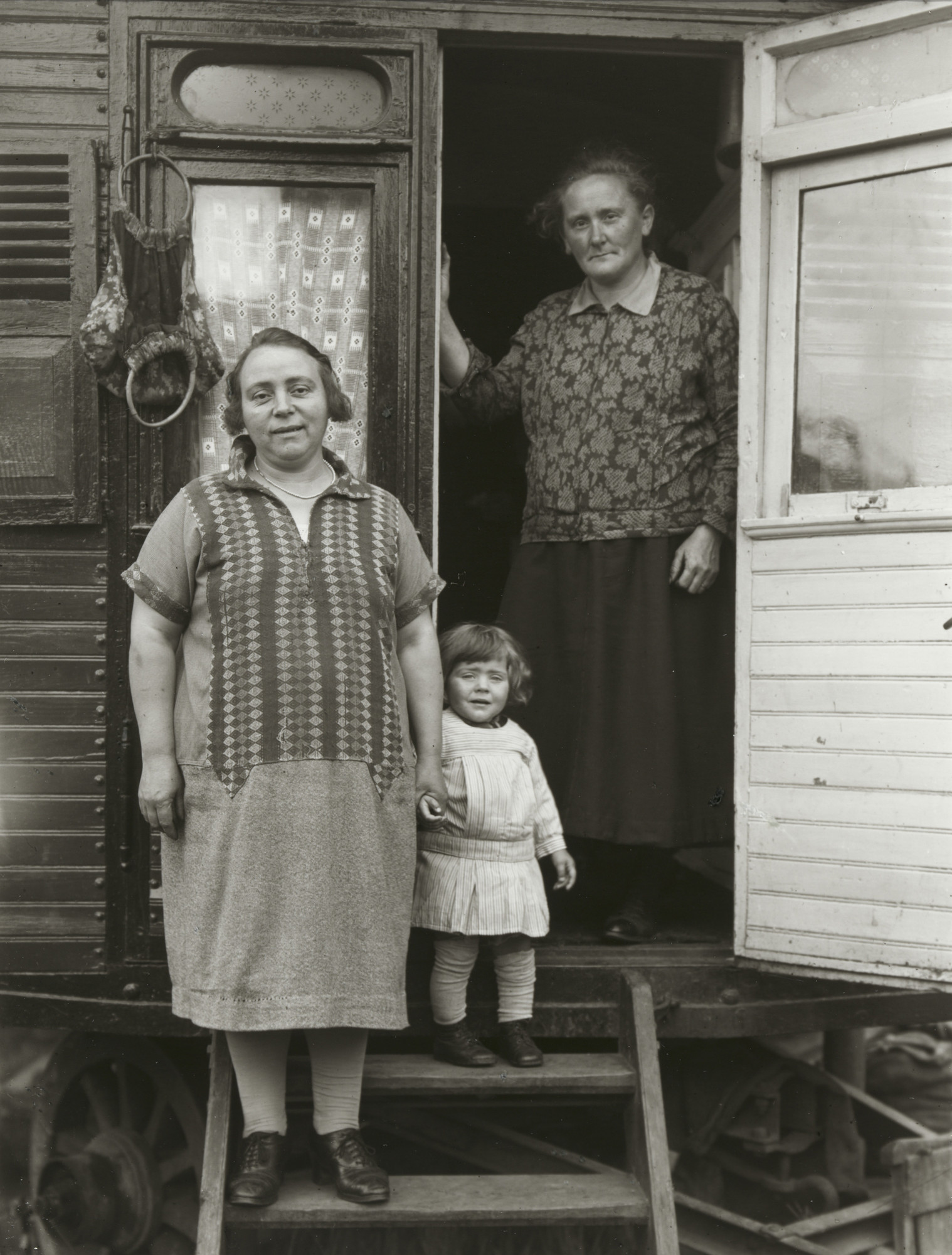 August Sander. Three Generations in Fairground Caravan. 1926-32