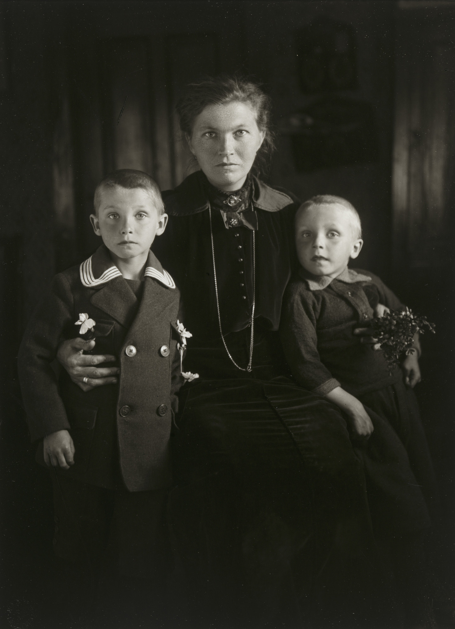 August Sander. Widow with her Sons. c. 1921